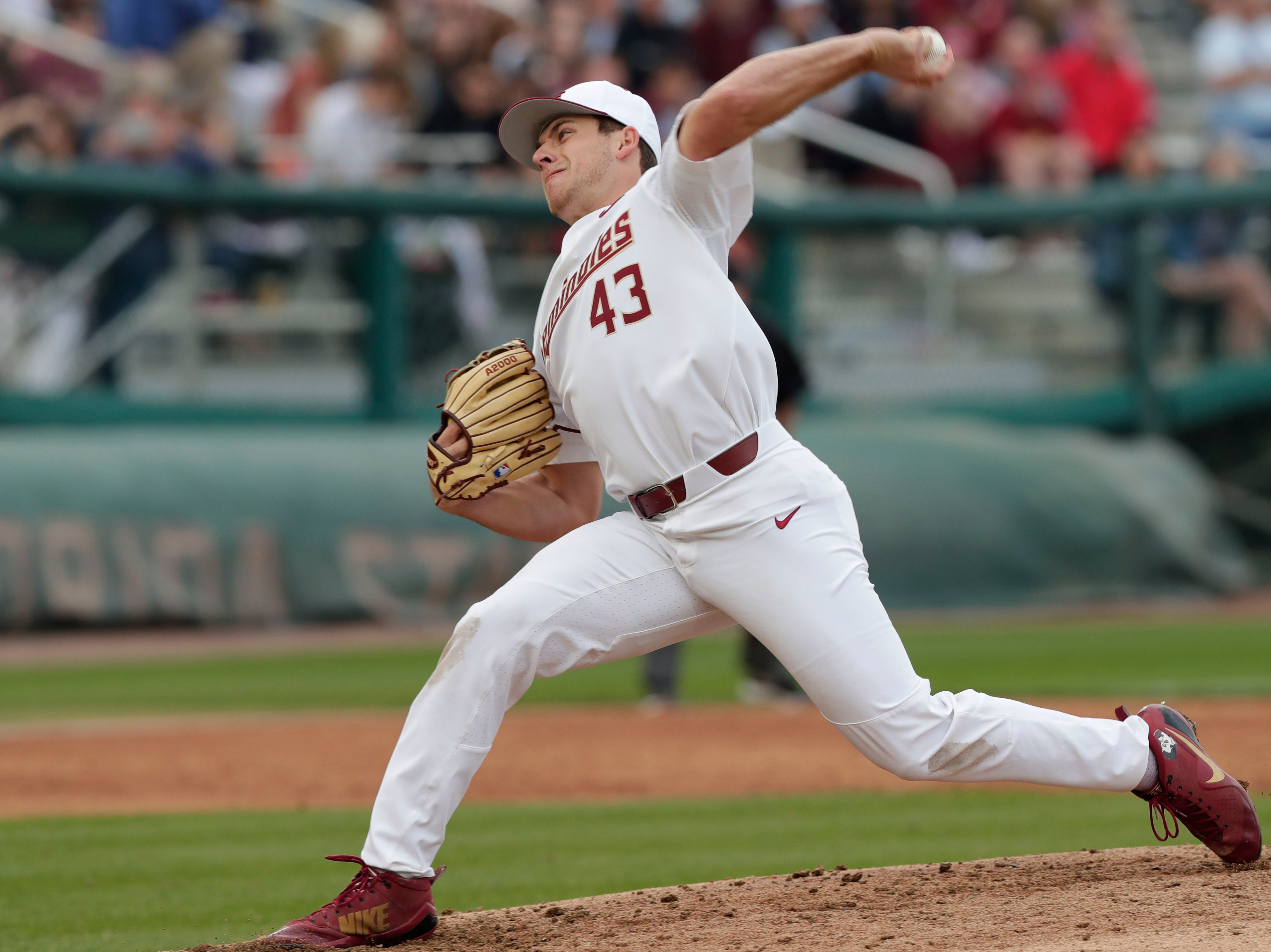 Florida State Seminoles left handed pitcher/Outfielder Drew Parrish (43) pitches the ball as the Florida State Seminoles host the Maine Black Bears in the 2019 season opener game, Friday Feb. 15, 2019.