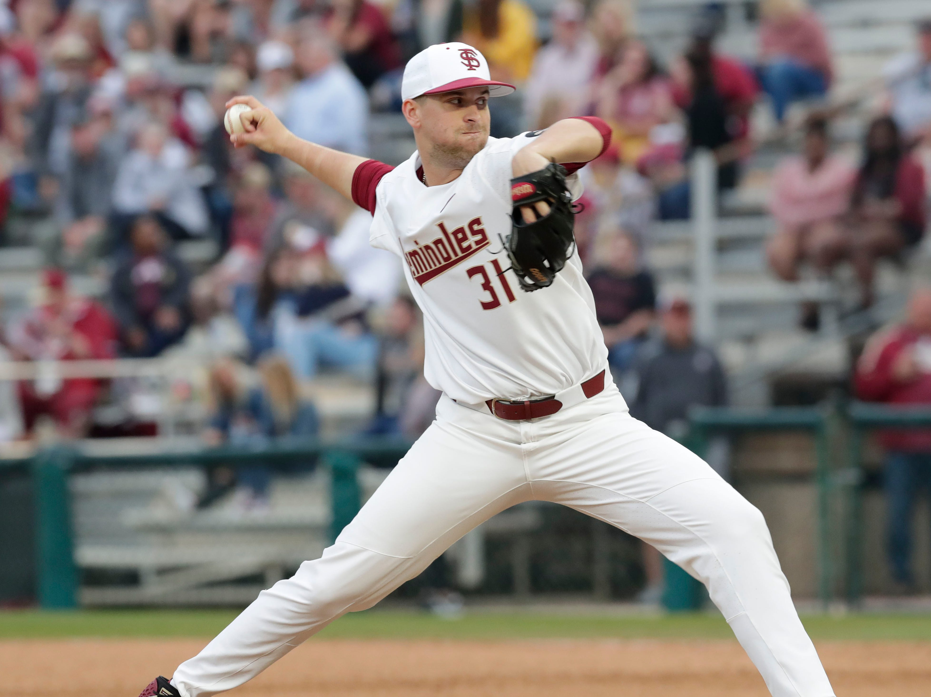 Florida State Seminoles right handed pitcher Conor Grady (31) throws a pitch as the Florida State Seminoles host the Maine Black Bears in the 2019 season opener game, Friday Feb. 15, 2019.