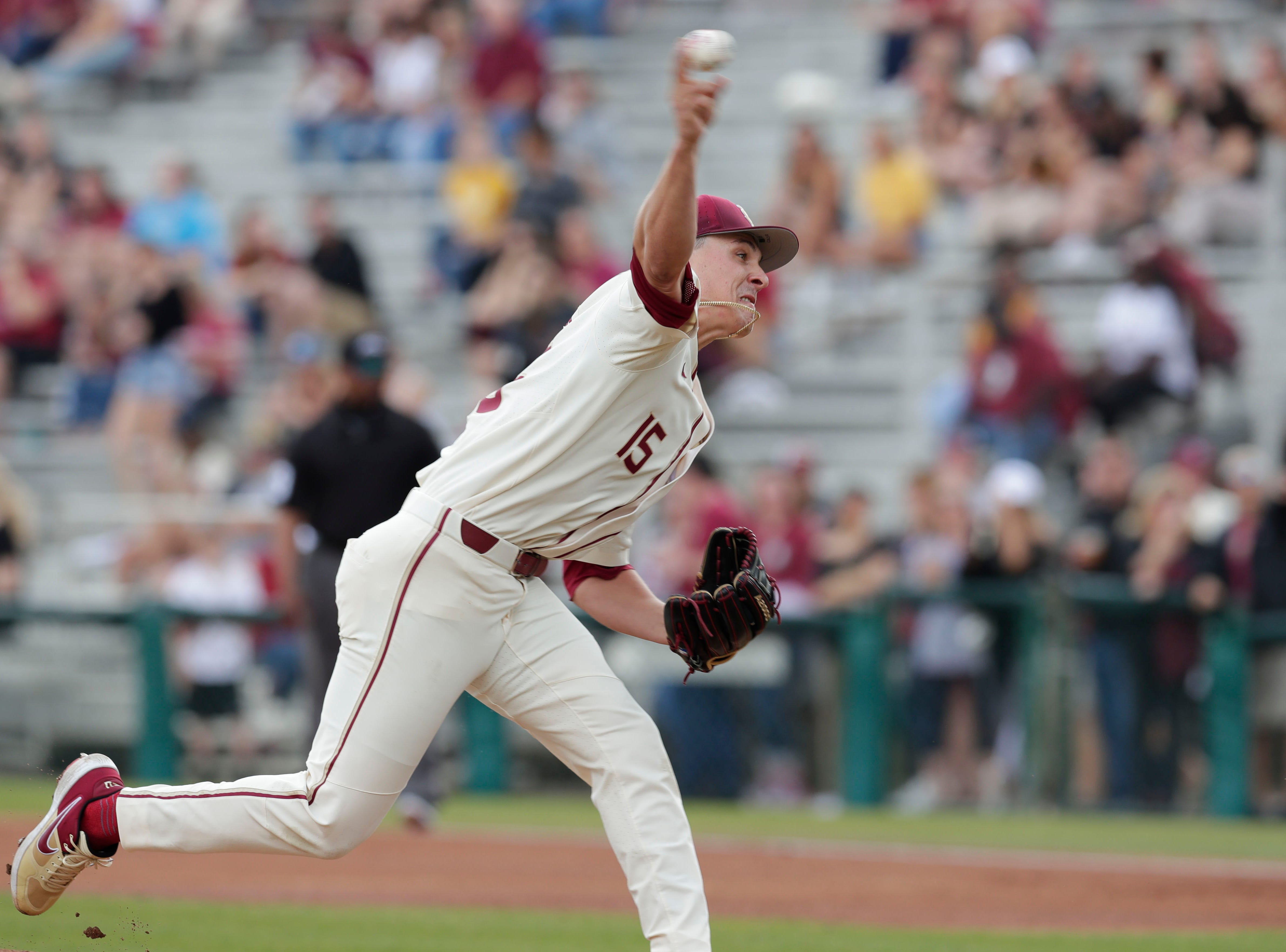 Florida State Seminoles right handed pitcher CJ Van Eyk (15) pitches to the batter as the Florida State Seminoles host the Maine Black Bears for the second game of the series, Saturday Feb. 16, 2019.
