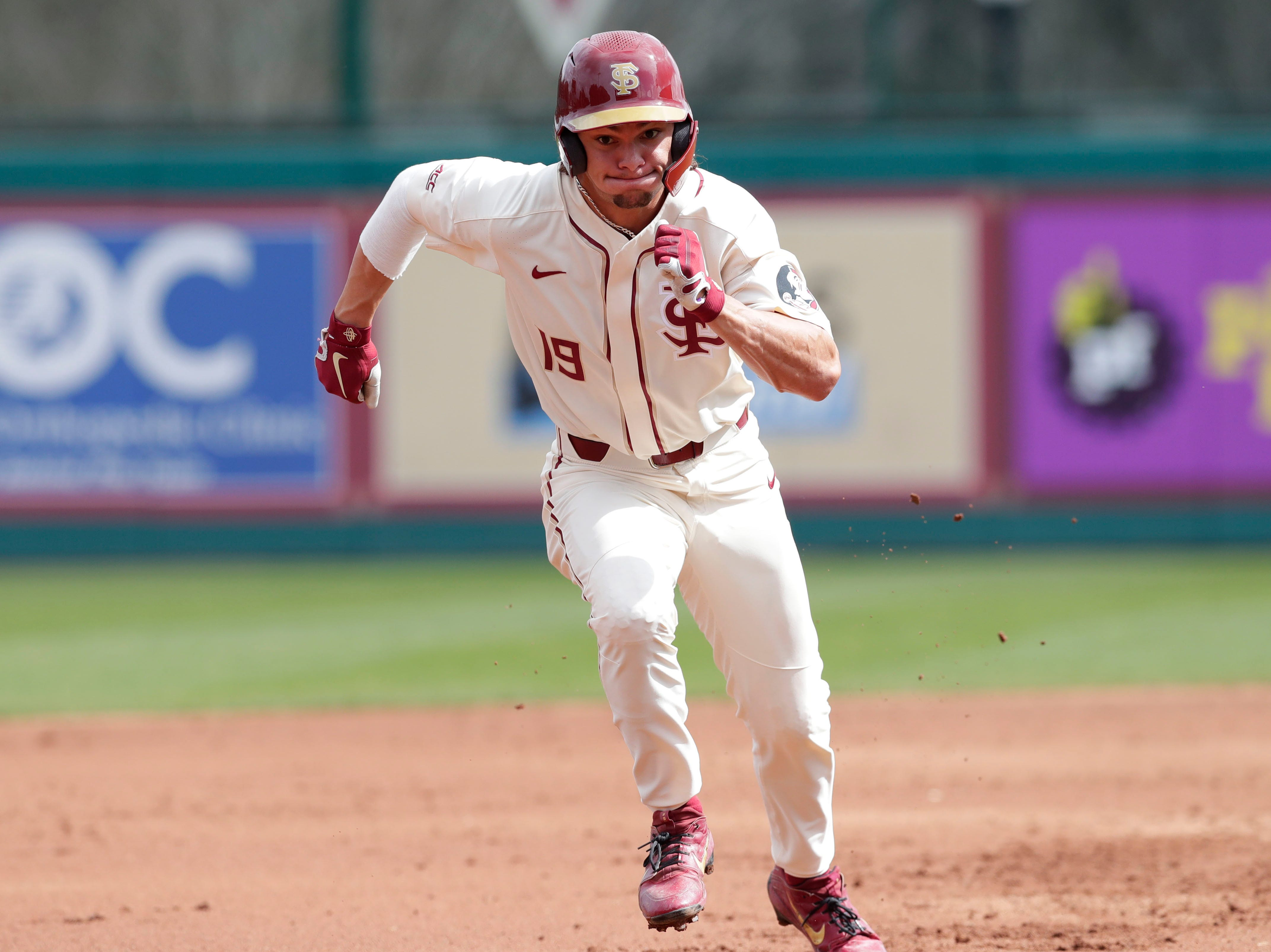 Florida State Seminoles outfielder Elijah Cabell (19) makes a sun for third base as the Florida State Seminoles host the Maine Black Bears for the second game of the series, Saturday Feb. 16, 2019.