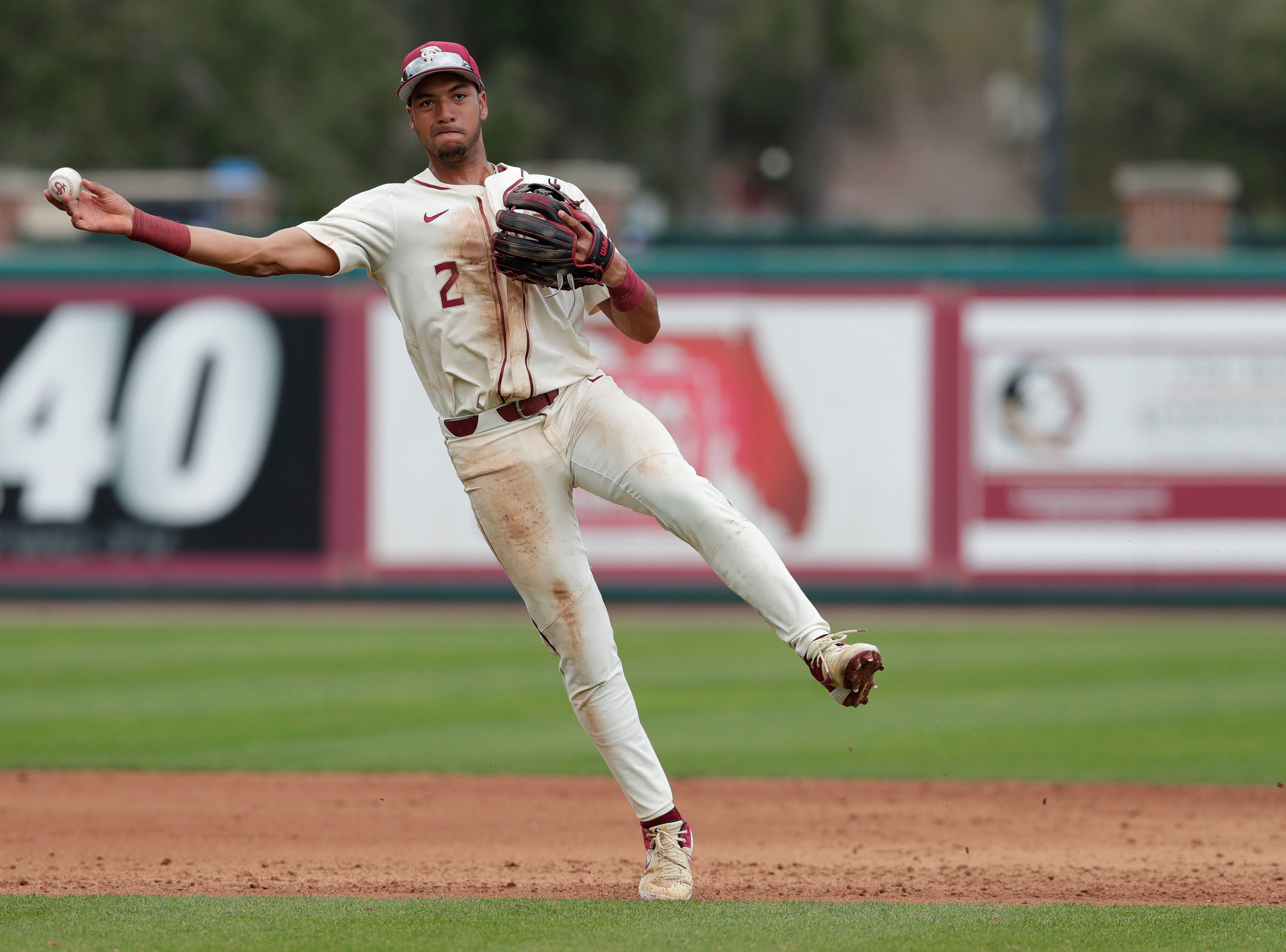 Florida State Seminoles infielder Nander De Sedas (2) picks up a ground ball and throws to his teammate to get the out at first. The Florida State Seminoles host the Maine Black Bears for the second game of the series, Saturday Feb. 16, 2019.