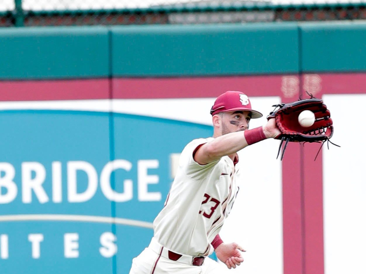 Florida State Seminoles outfielder/left handed pitcher Reese Albert (23) catches a fly ball as the Florida State Seminoles host the Maine Black Bears for the second game of the series, Saturday Feb. 16, 2019.