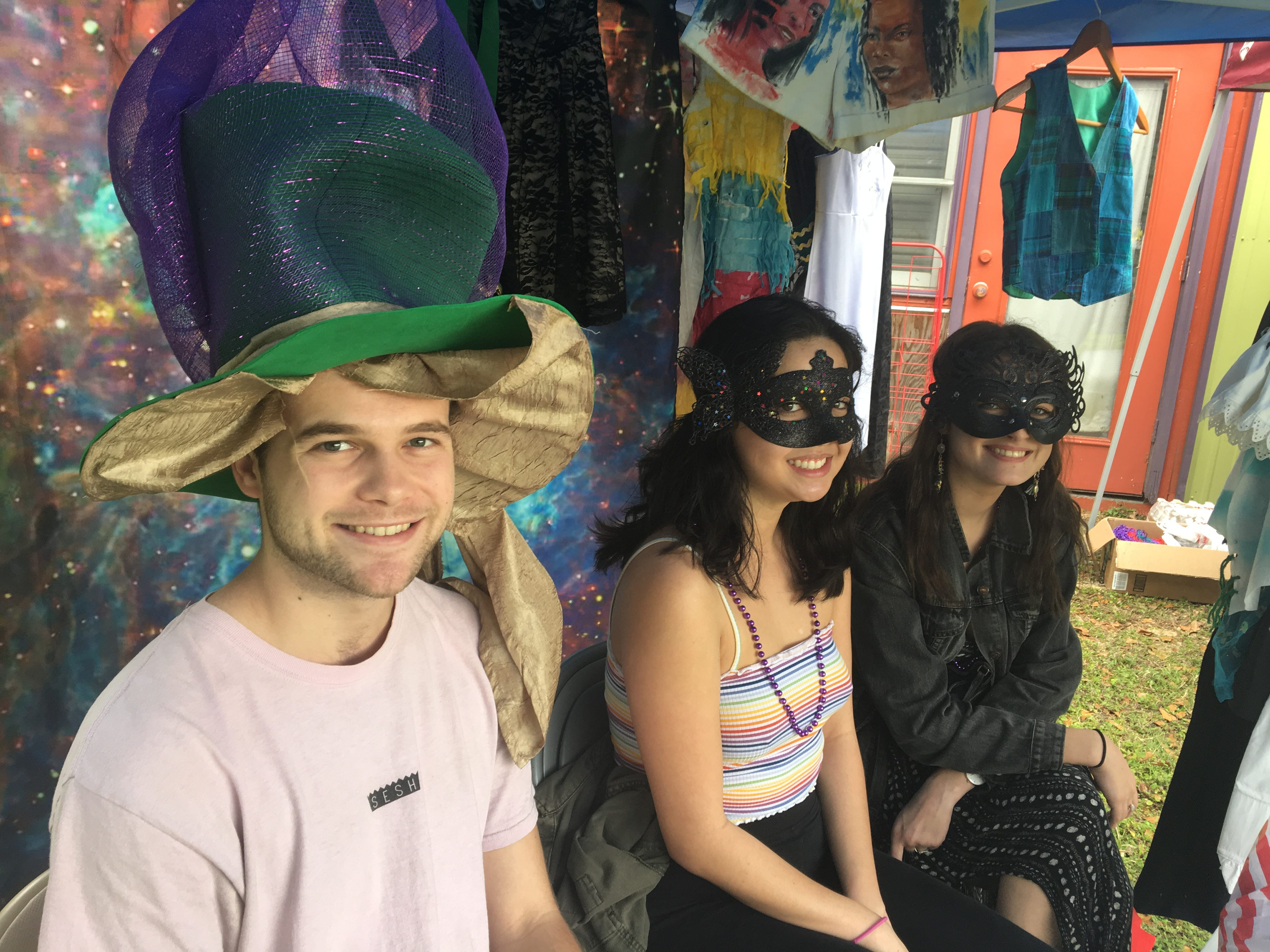 Harry James, 21, Amanda Caplan, 21, and Apolline Demiraj, 20, pose for a photo at ArtiGras 2019's costume booth.