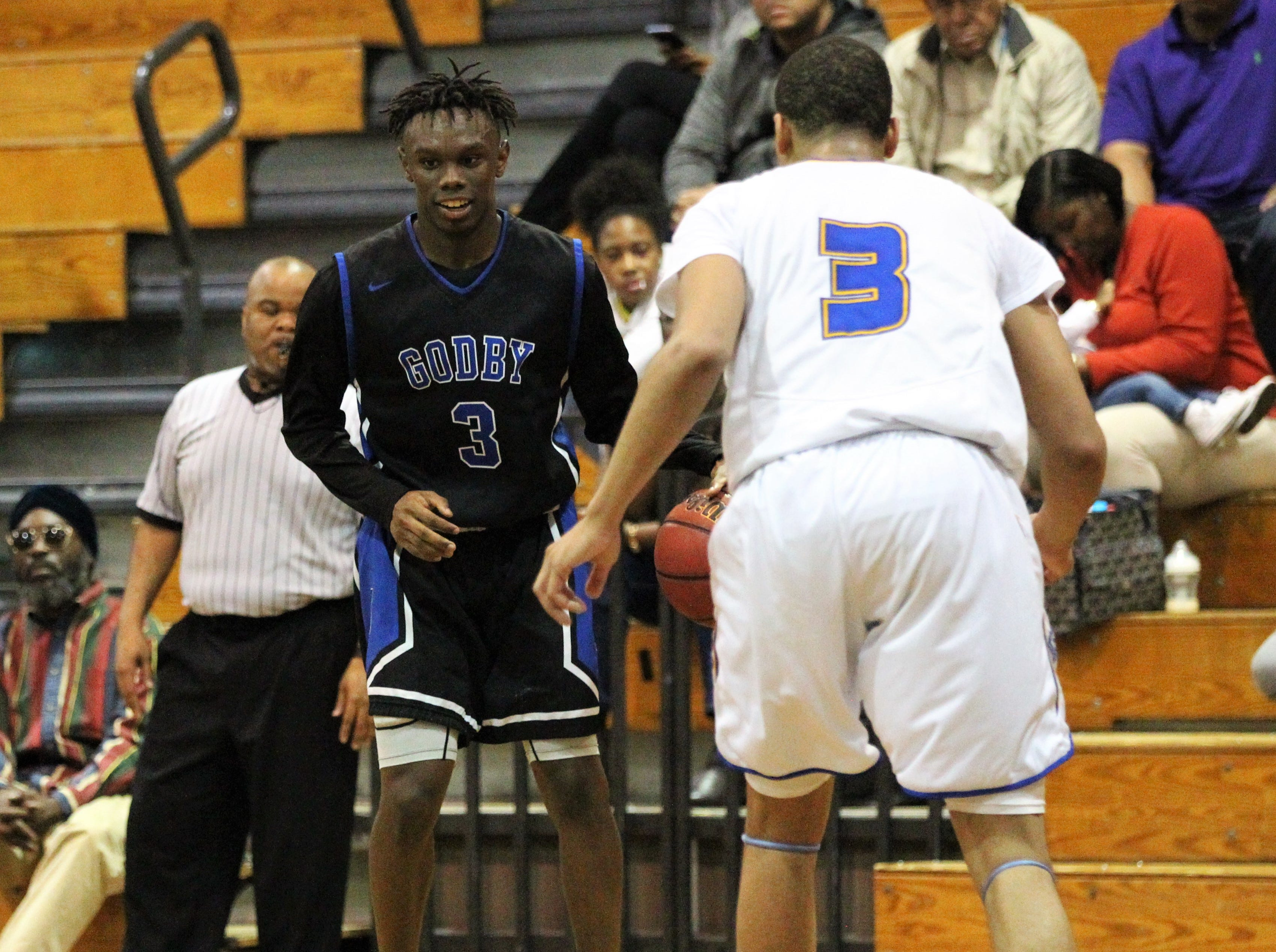 Godby's Deshawn Rucker looks for dribbling room as Rickards' boys basketball team beat Godby 58-47 during a District 2-6A championship game at Chiles on Feb. 15, 2019.