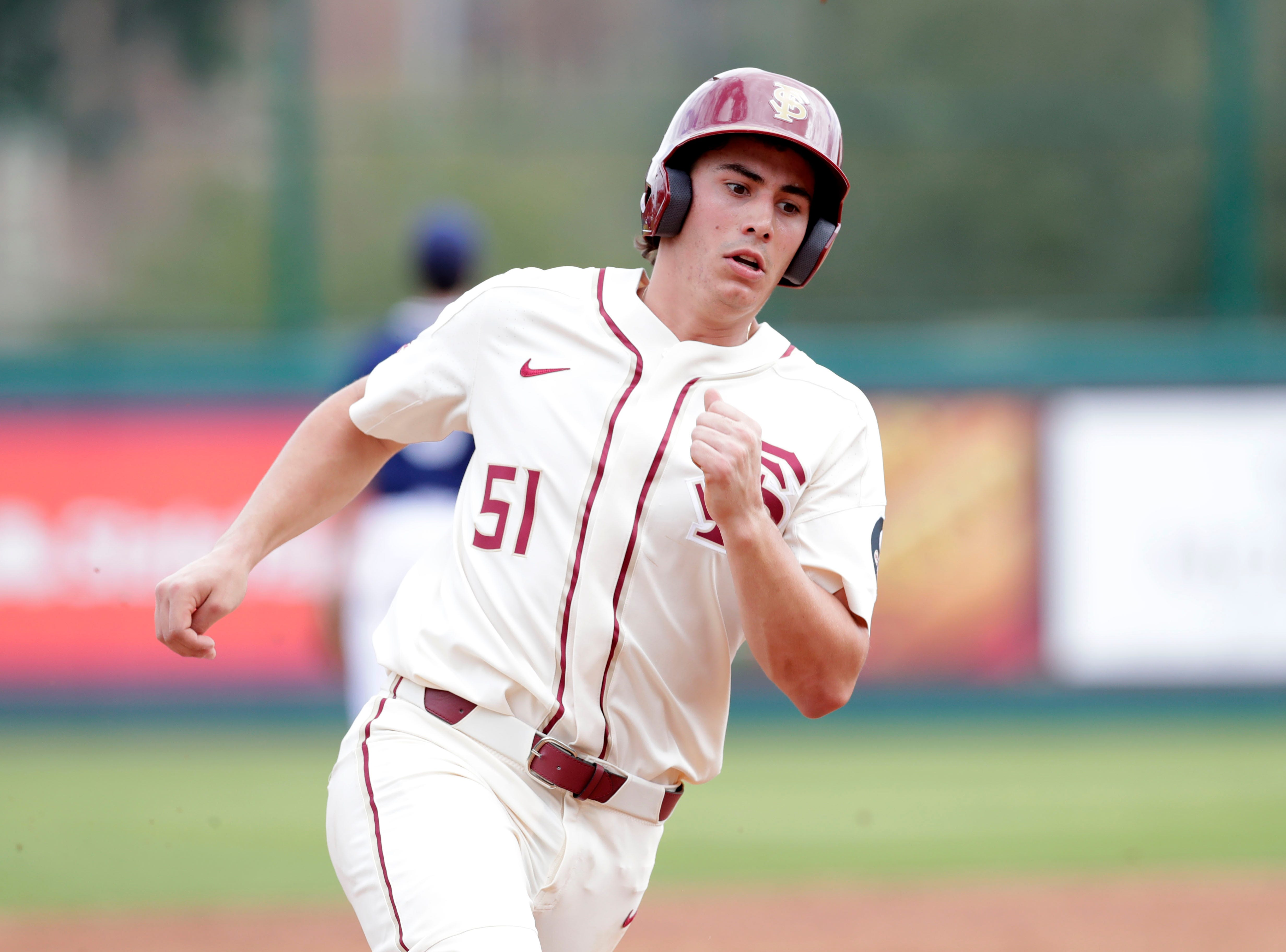 Florida State Seminoles infielder Nico Baldor (51) rounds third base on his way home as the Florida State Seminoles host the Maine Black Bears for the second game of the series, Saturday Feb. 16, 2019.