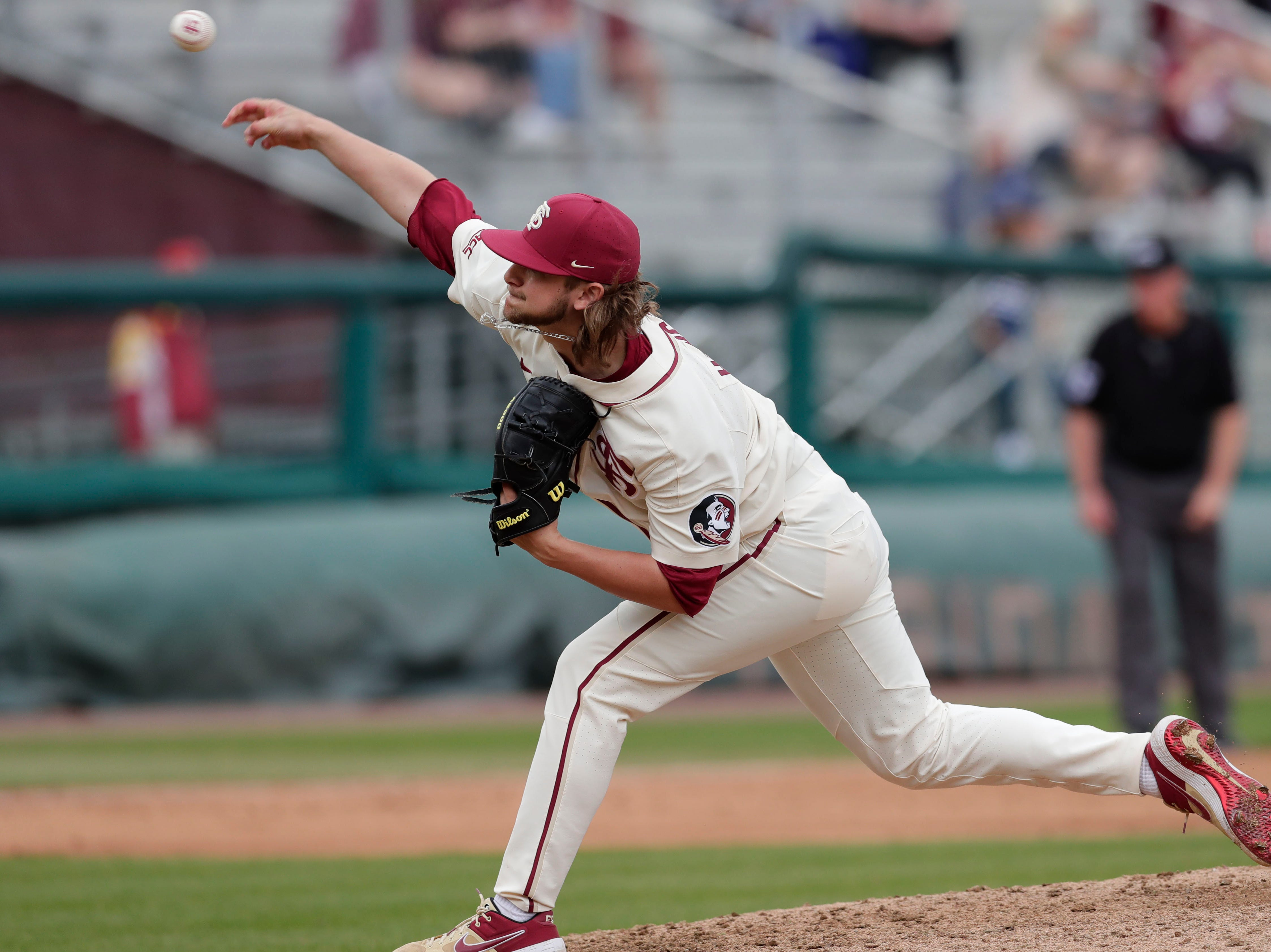 Florida State Seminoles infielder/right handed pitcher Cade Hungate (7)t pitches as he Florida State Seminoles host the Maine Black Bears for the second game of the series, Saturday Feb. 16, 2019.