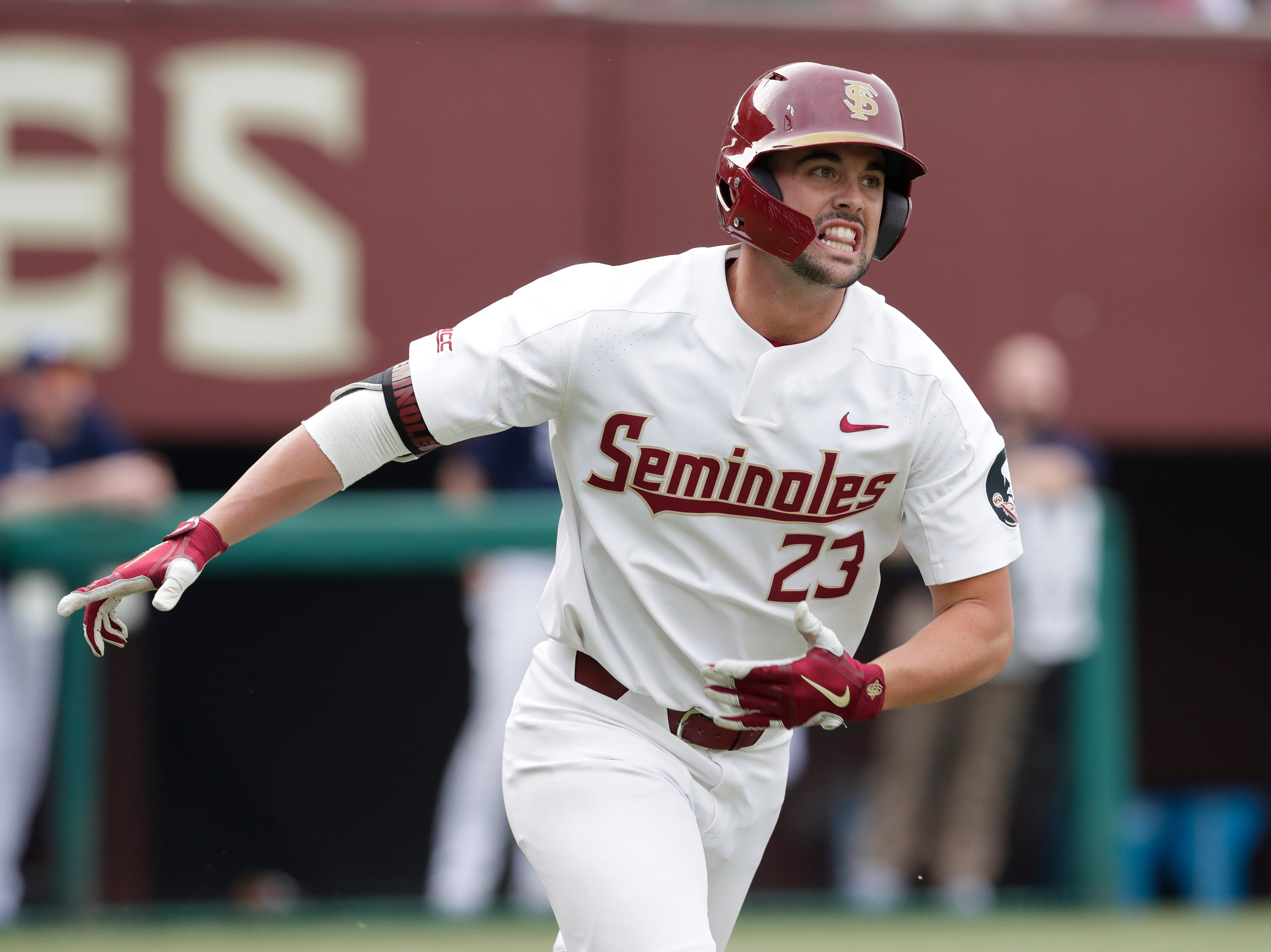 Florida State Seminoles outfielder/left handed pitcher Reese Albert (23) runs to first after hitting the pitch. The Florida State Seminoles host the Maine Black Bears in the 2019 season opener game, Friday Feb. 15, 2019.