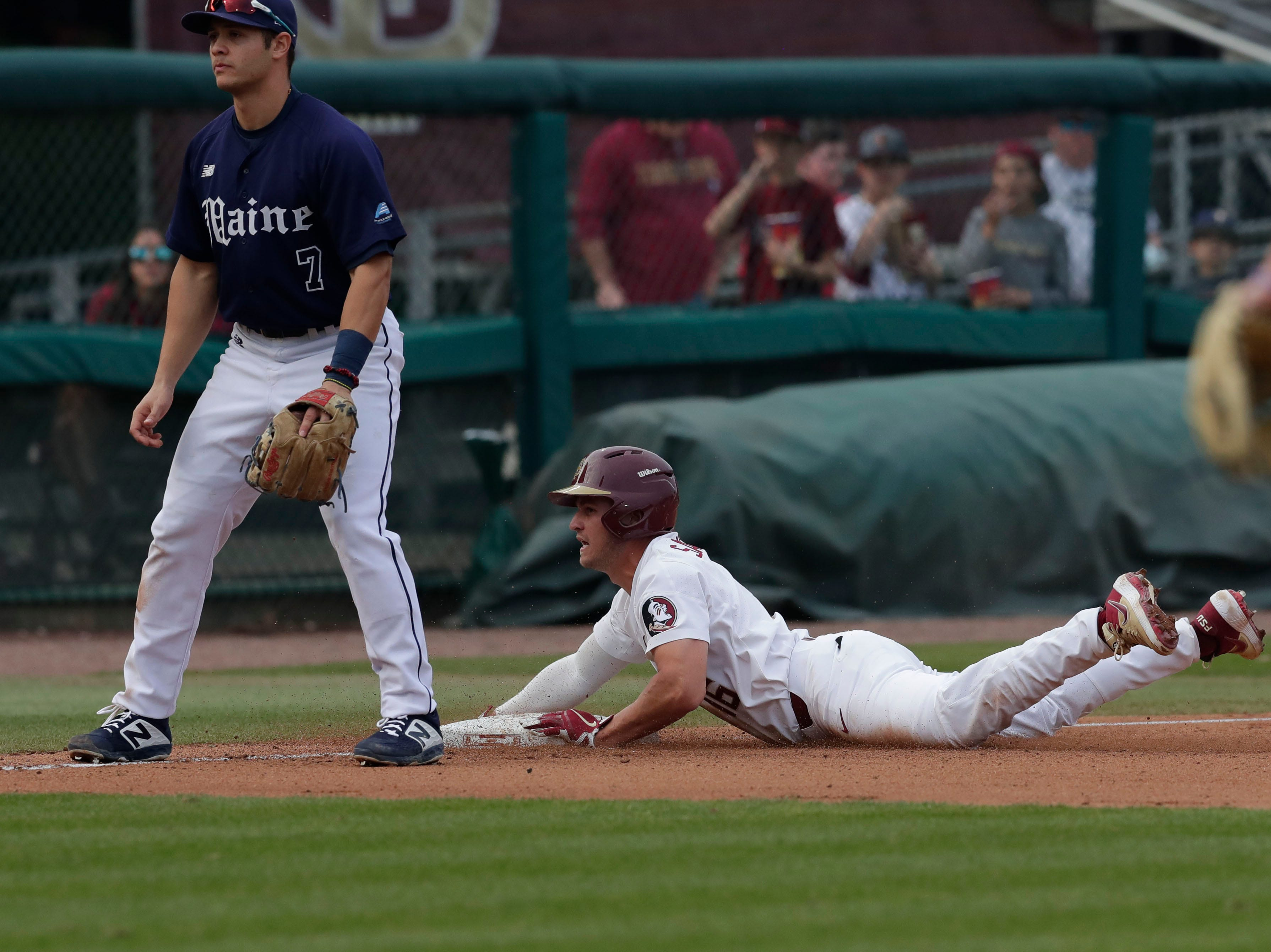Florida State Seminoles infielder Mike Salvatore (16) slides into third base as the Florida State Seminoles host the Maine Black Bears in the 2019 season opener game, Friday Feb. 15, 2019.
