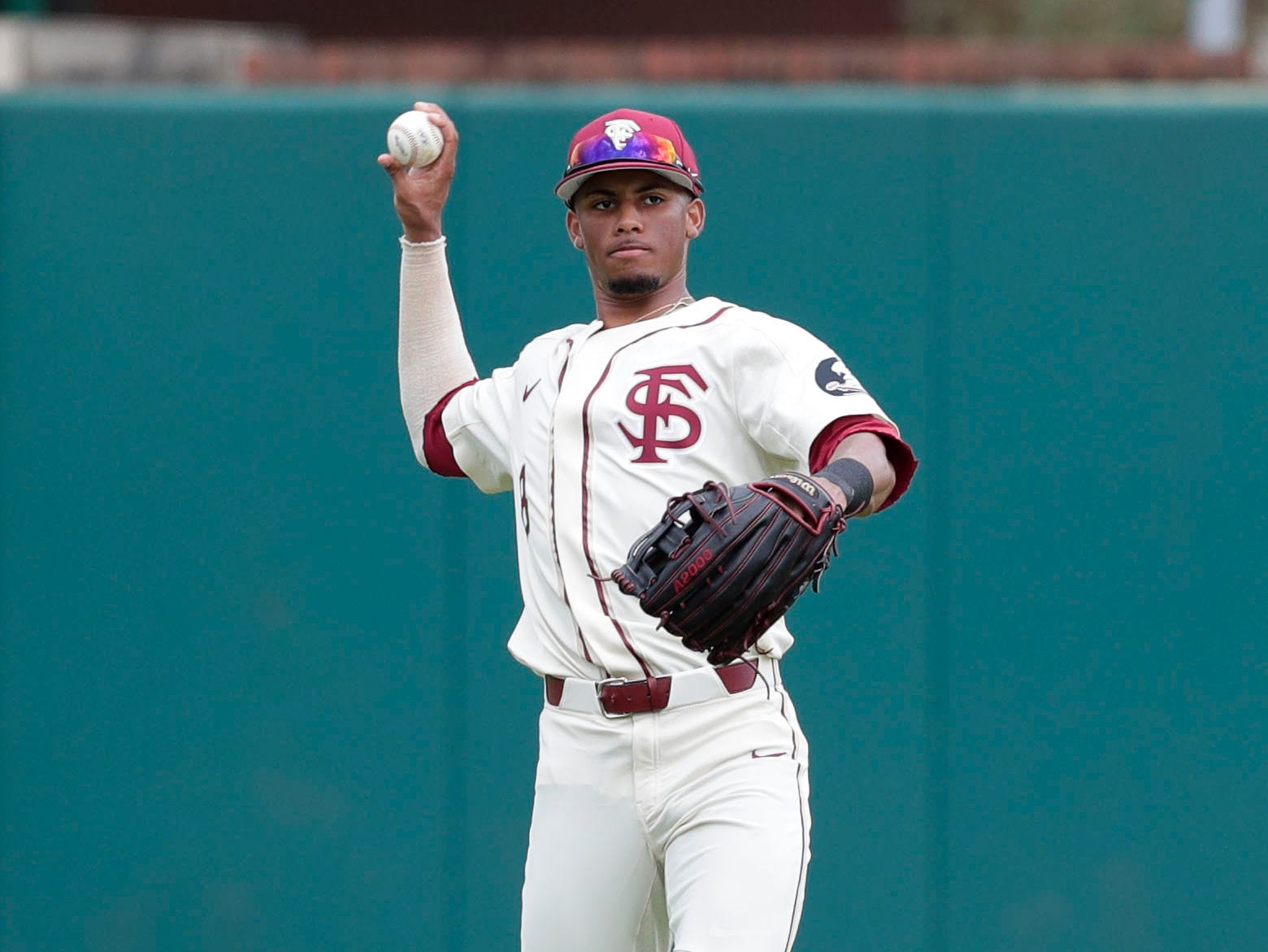 Florida State Seminoles outfielder/right handed Pitcher J.C. Flowers (8) throws the ball to the infield as the Florida State Seminoles host the Maine Black Bears for the second game of the series, Saturday Feb. 16, 2019.