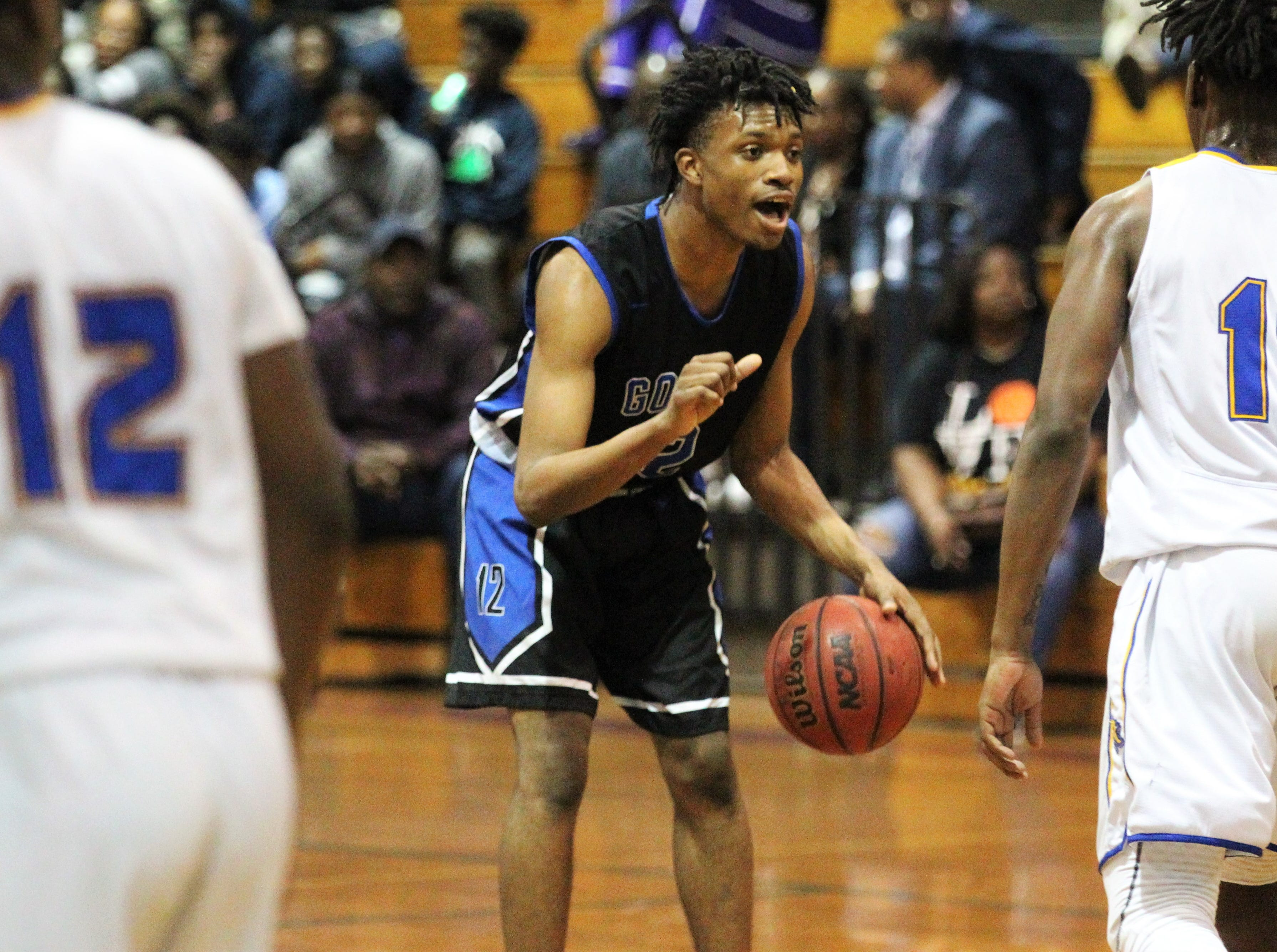 Godby's Steve Laurent calls out a play as Rickards' boys basketball team beat Godby 58-47 during a District 2-6A championship game at Chiles on Feb. 15, 2019.