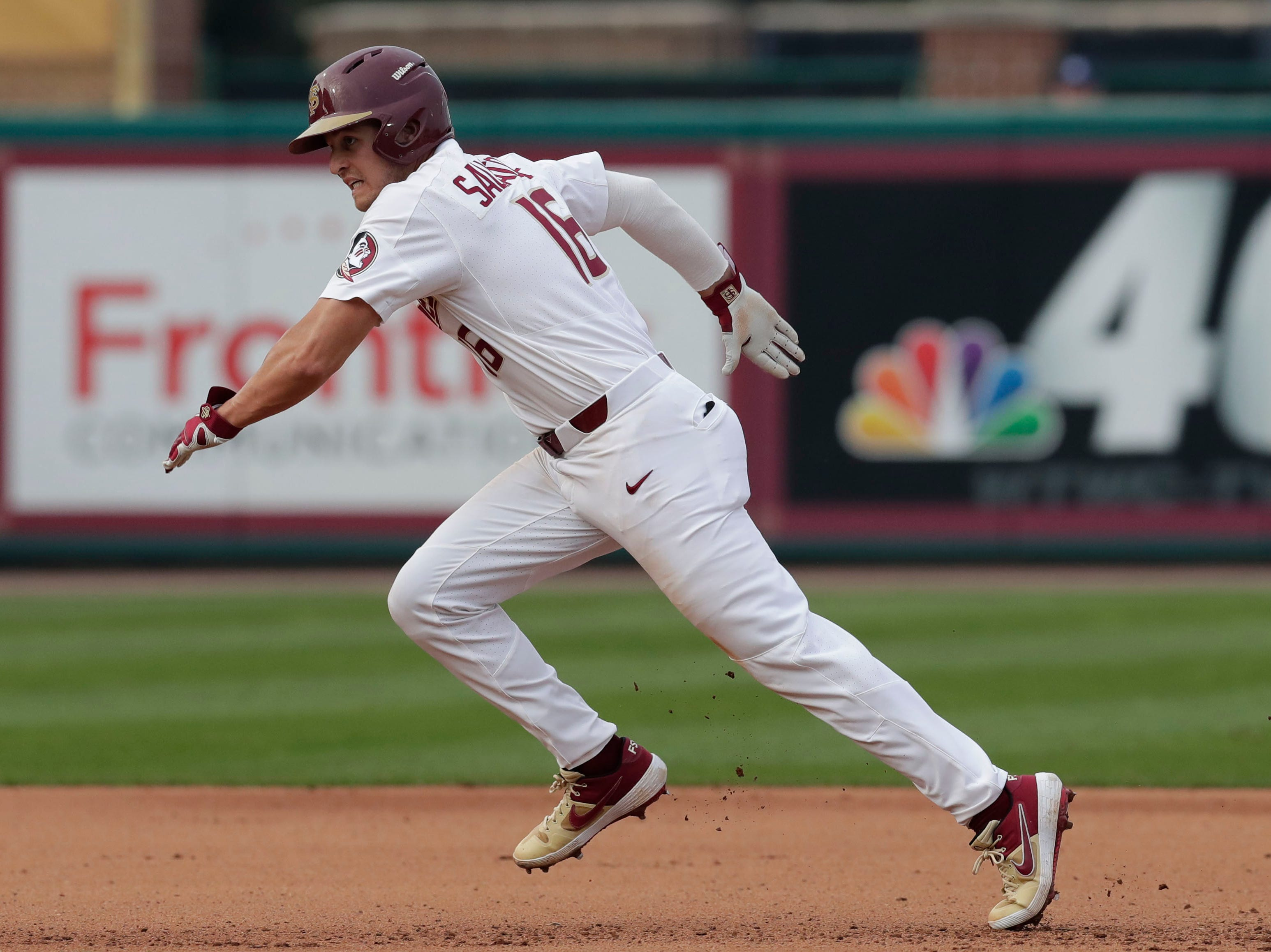 Florida State Seminoles infielder Mike Salvatore (16) makes a run for third as the Florida State Seminoles host the Maine Black Bears in the 2019 season opener game, Friday Feb. 15, 2019.