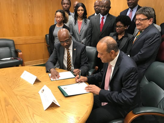Florida A&M President Larry  Robinson, front left, and Dr. William F. Owen Jr., dean and chancellor of the Ross University School of Medicine sign medical studies agreement. (Feb. 15, 2019).