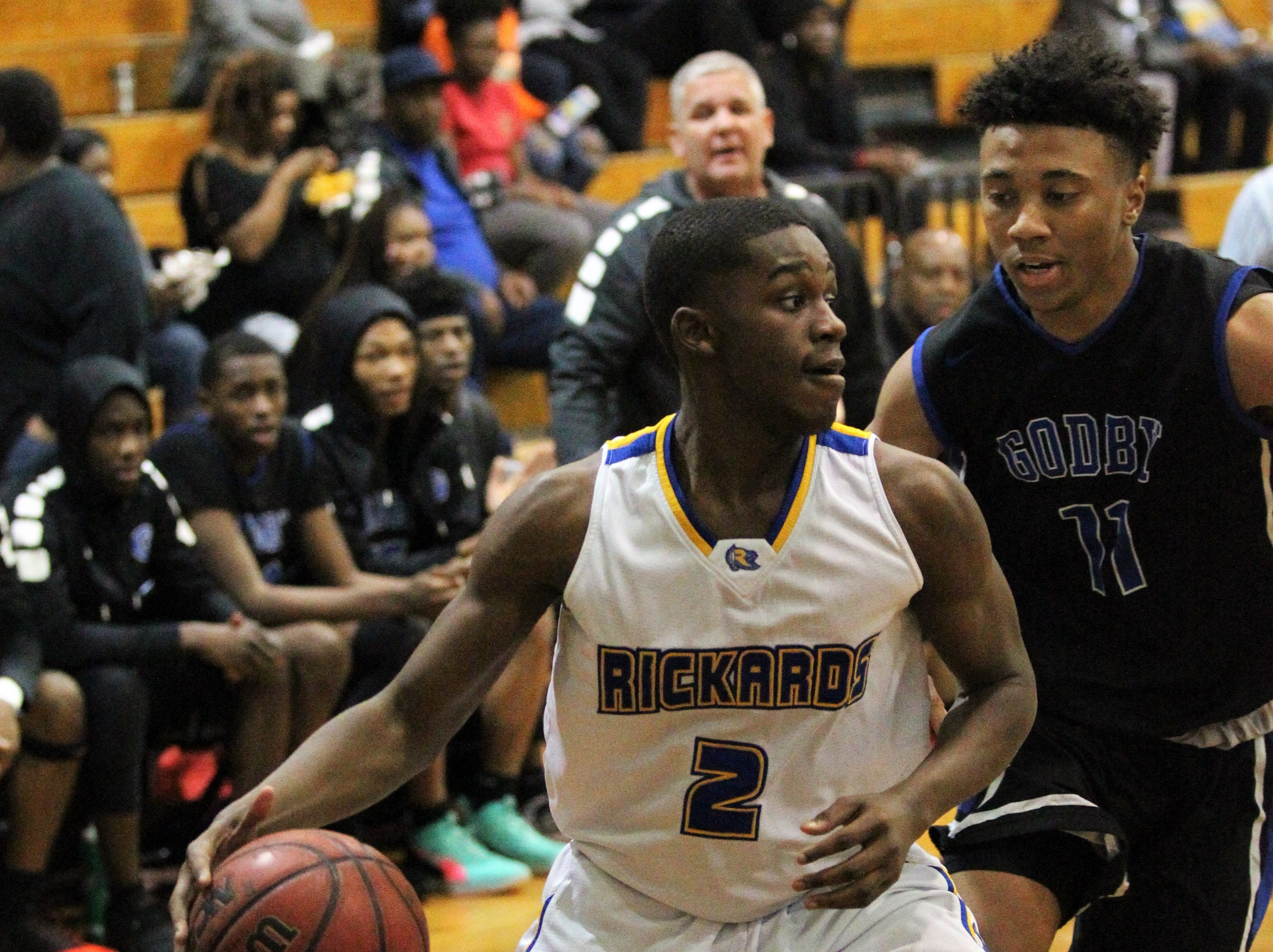 Rickards' Otis Young drives baseline as Rickards' boys basketball team beat Godby 58-47 during the District 2-6A championship at Chiles on Feb. 15, 2019.