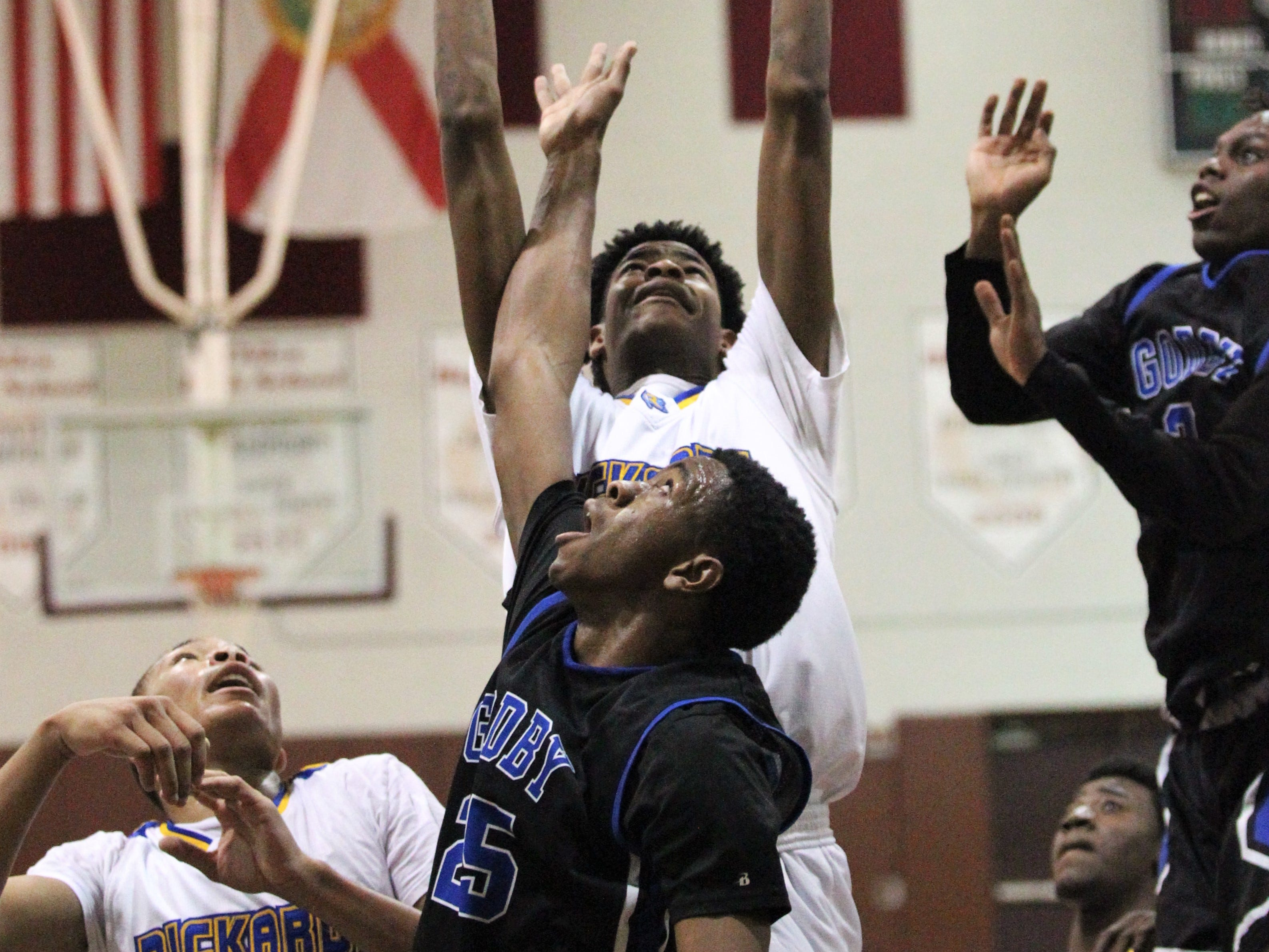 Rickards' Wynn Michael goes up for a rebound as Rickards' boys basketball team beat Godby 58-47 during the District 2-6A championship at Chiles on Feb. 15, 2019.