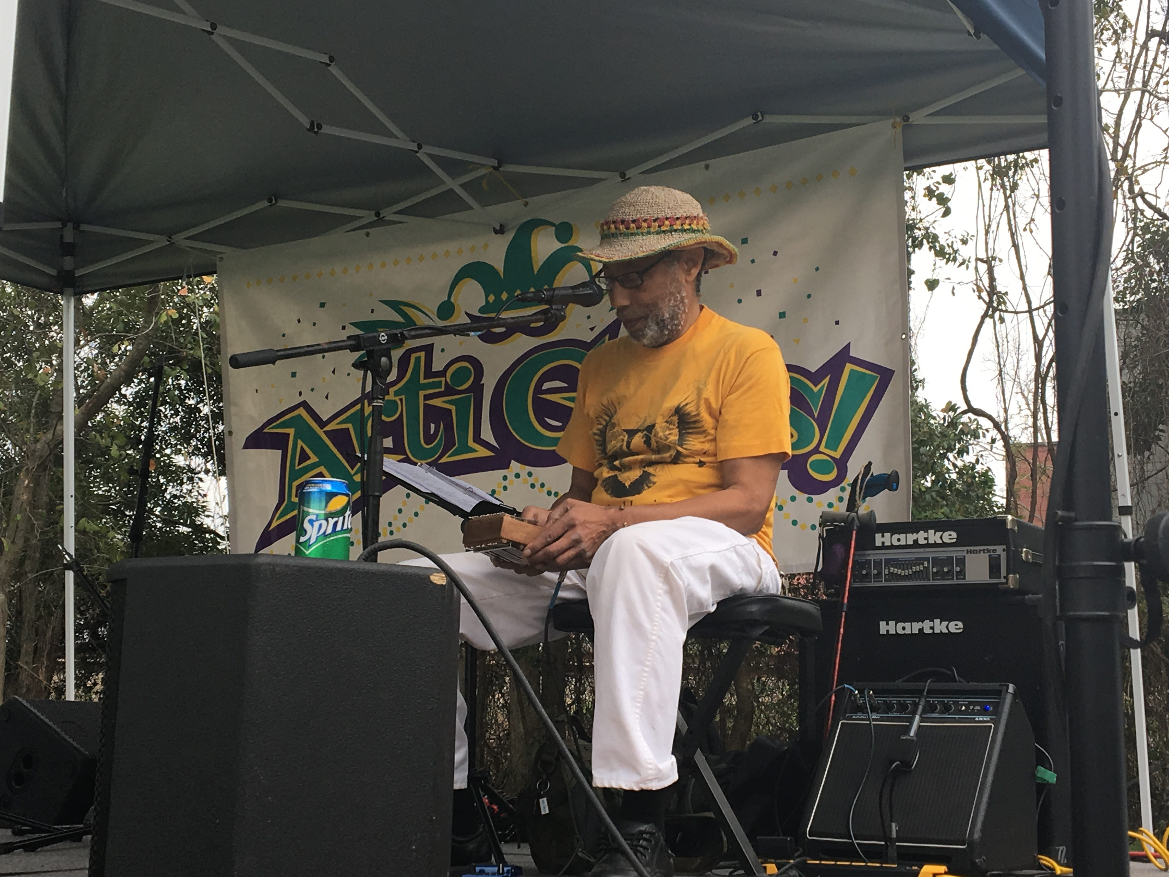 Olusegun Williams, a musician and storyteller, plays the kalimba, a South African chromatic instrument, at ArtiGras 2019.
