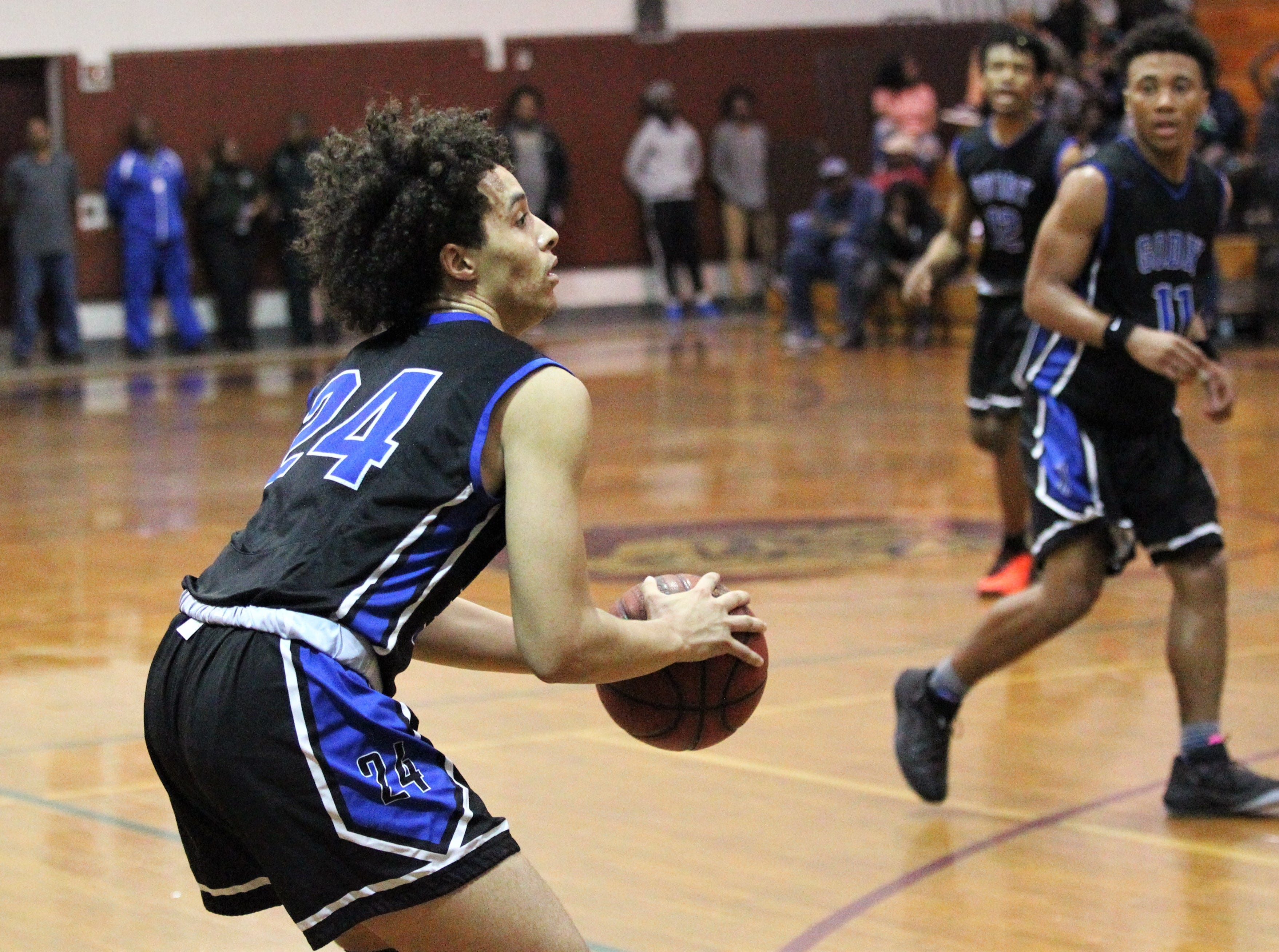 Godby's A.J. Shingles eyeballs a 3-pointer as Rickards' boys basketball team beat Godby 58-47 during a District 2-6A championship game at Chiles on Feb. 15, 2019.