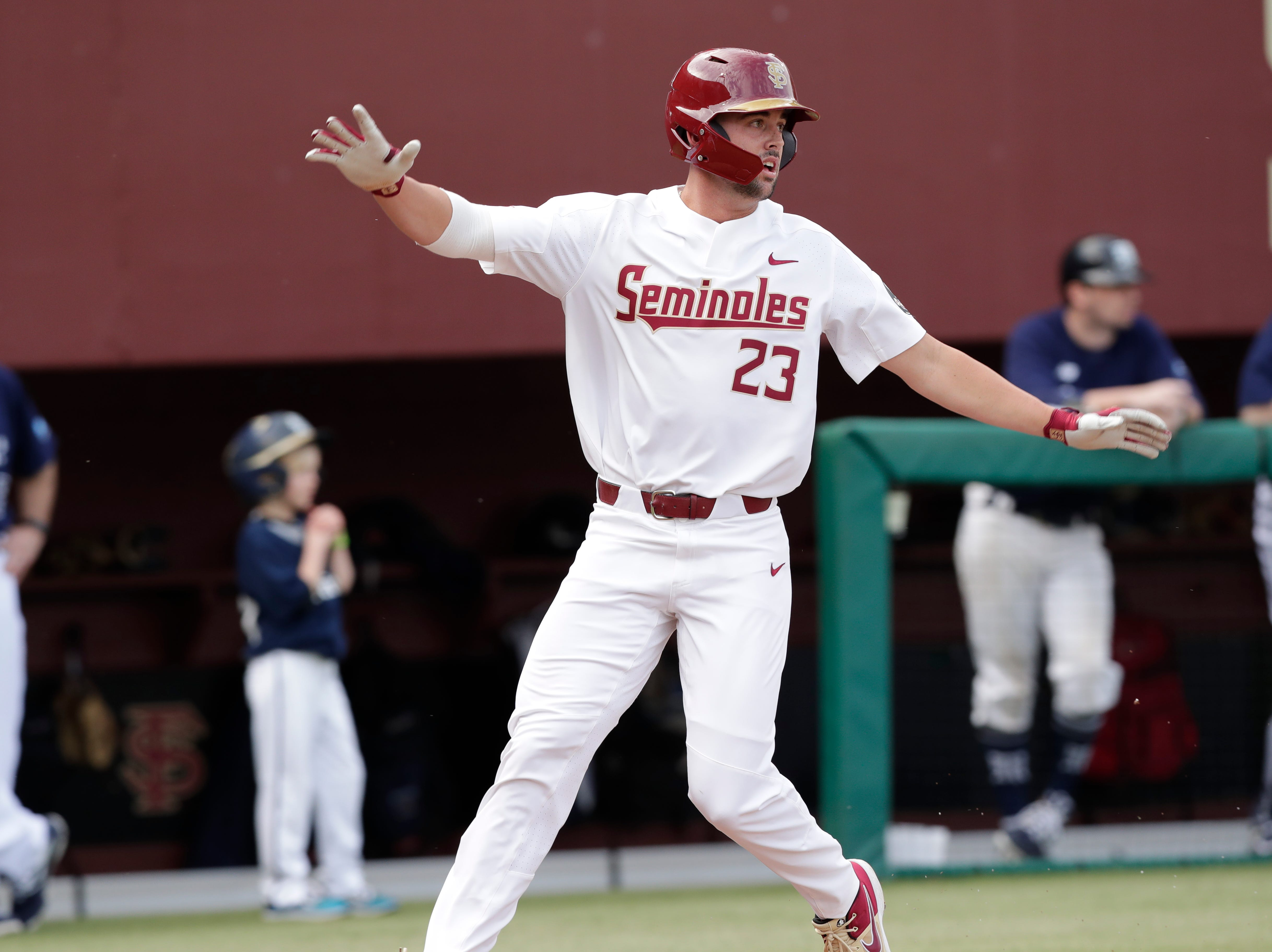 Florida State Seminoles outfielder/left handed pitcher Reese Albert (23) celebrates his run as the Florida State Seminoles host the Maine Black Bears in the 2019 season opener game, Friday Feb. 15, 2019.