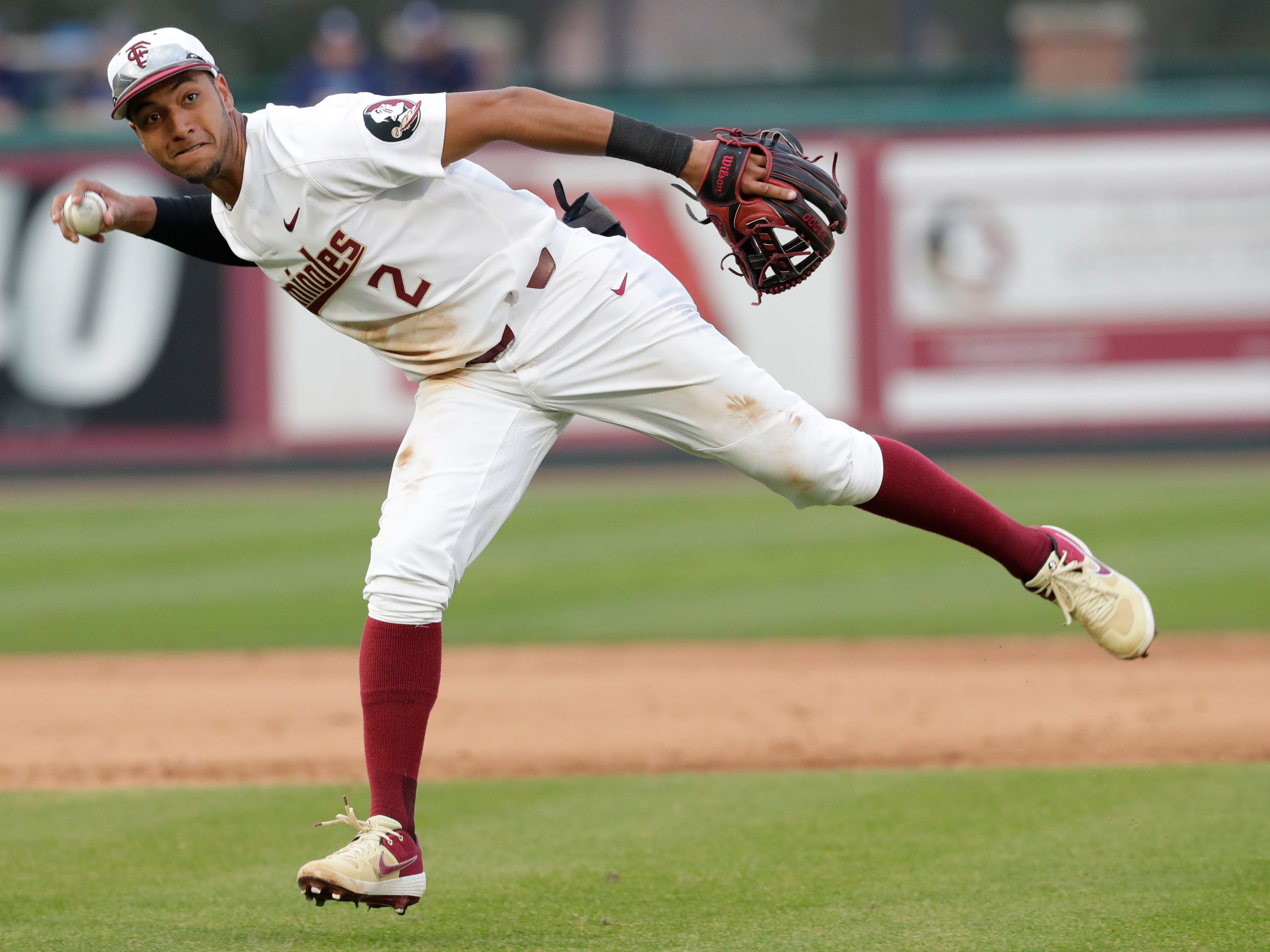 Florida State Seminoles infielder Nander De Sedas (2) throws to first to get the out as the Florida State Seminoles host the Maine Black Bears in the 2019 season opener game, Friday Feb. 15, 2019.