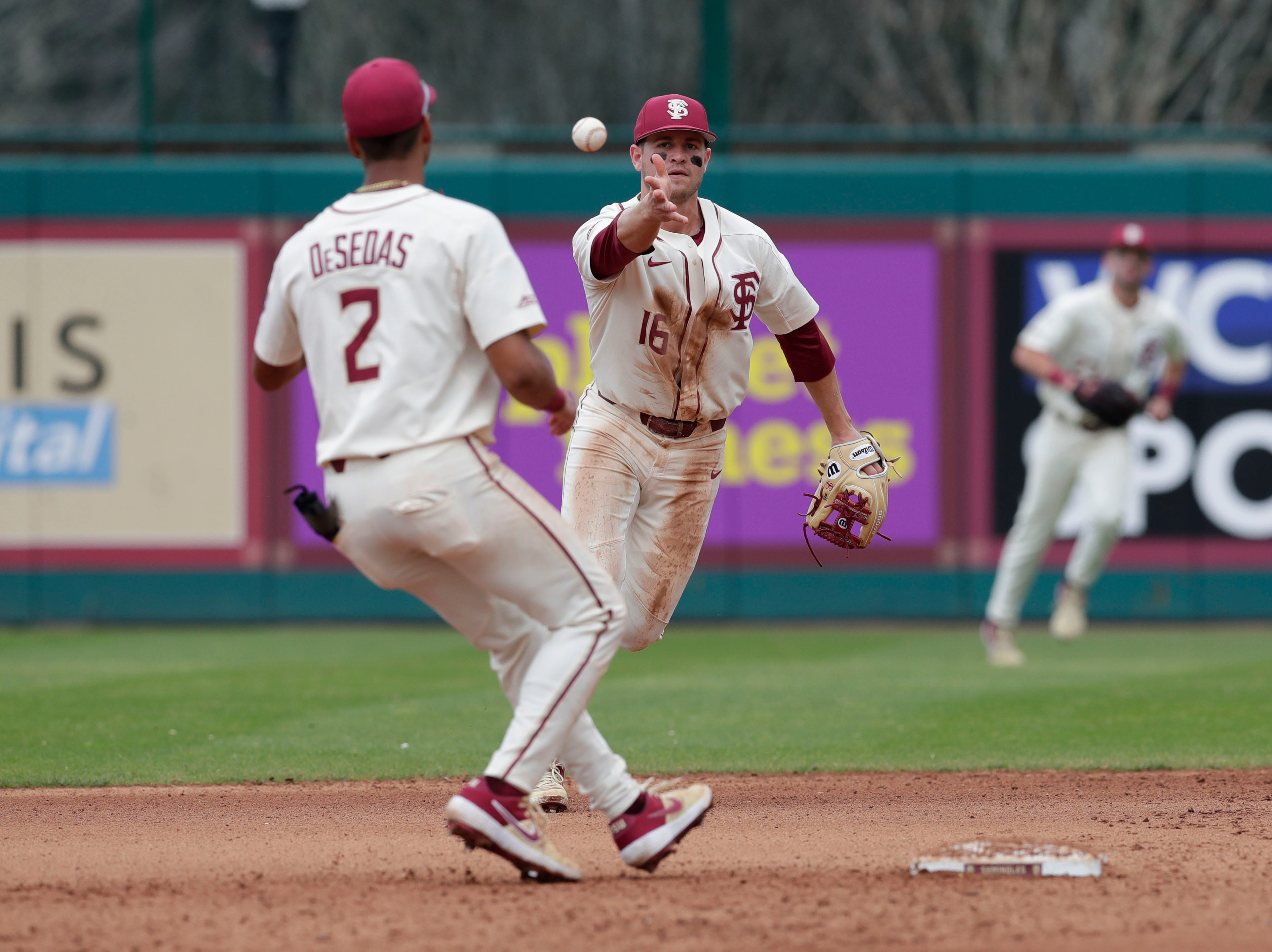 Florida State Seminoles infielder Mike Salvatore (16) tosses the ball to Florida State Seminole infielder Nander De Sedas to get the out at second. The Florida State Seminoles host the Maine Black Bears for the second game of the series, Saturday Feb. 16, 2019.