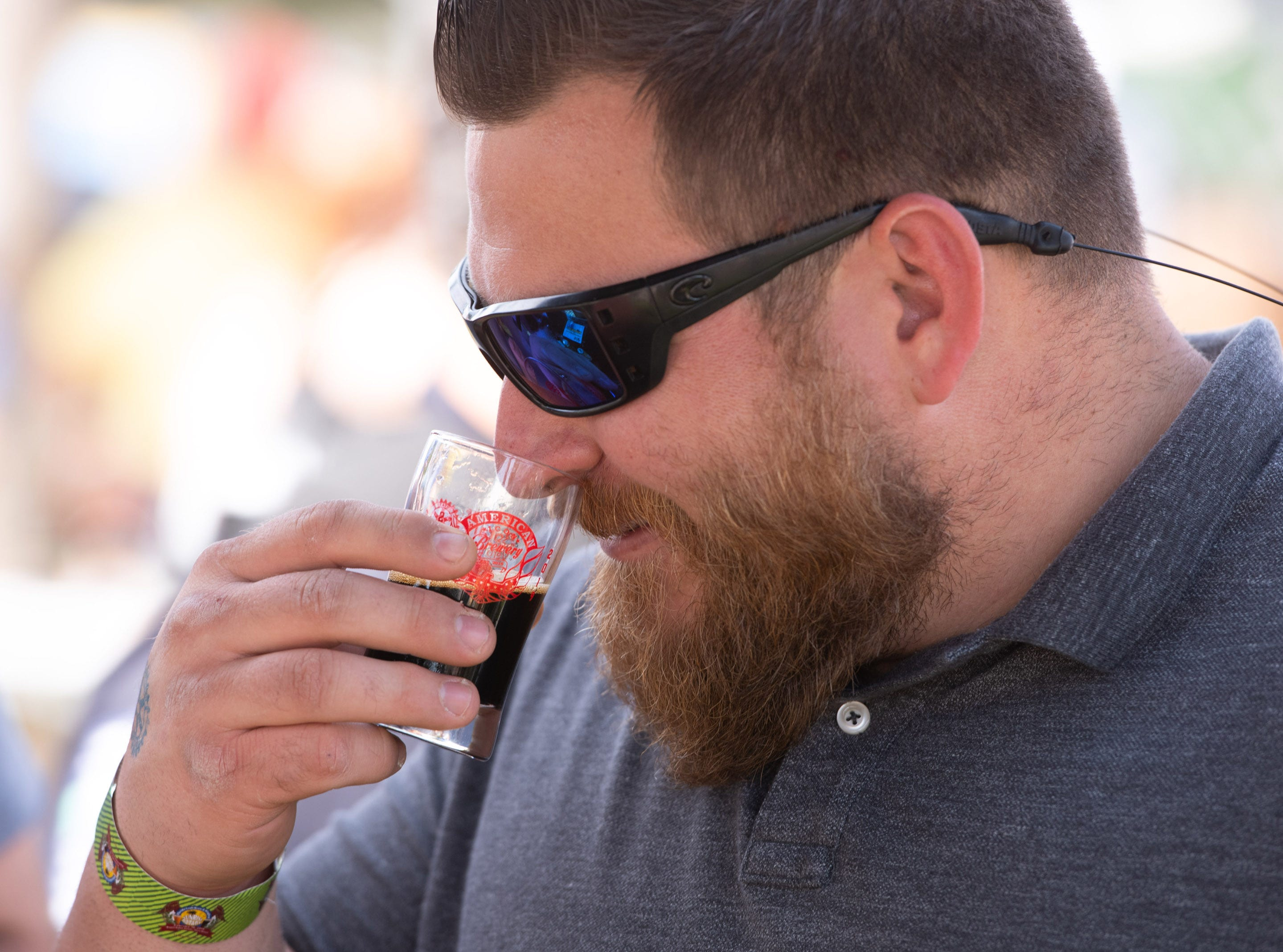 "Bryce Kluver, of Palm Bay, smells a beer before he takes a drink during the Florida Craft Brew and Wingfest at Royal Palm Pointe on Saturday, Feb. 16, 2019, in Vero Beach. ""This is my third time at the festival, I love it,"" Kluver said."