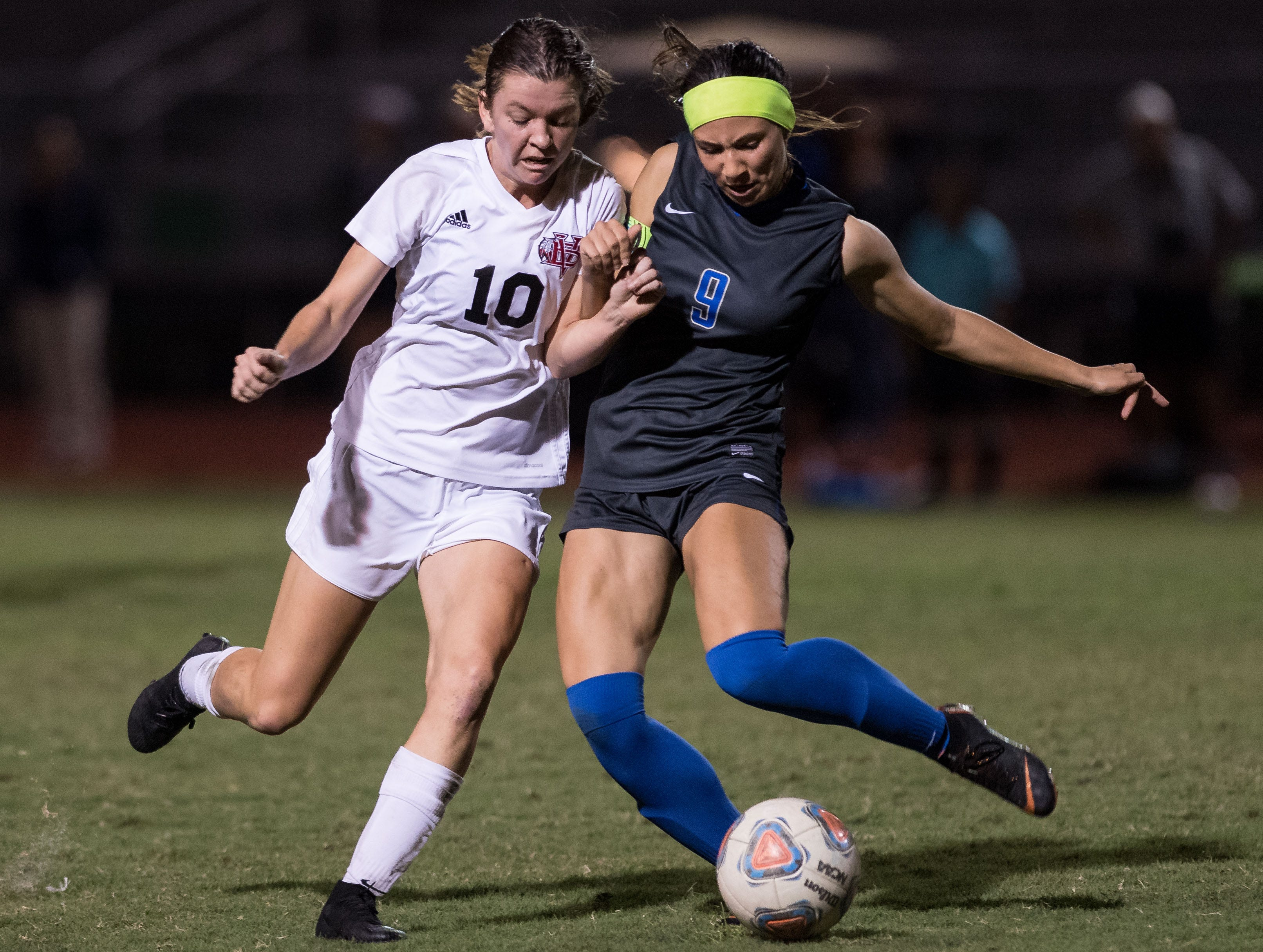 Vero Beach's Madelaine Rhodes (left) tries to drive to the goal past Cypress Bay's Alexandra Goffi during the second half of the high school girls soccer Class 5A state semifinal game Friday, Feb. 15, 2019, at Cypress Bay High School in Weston.