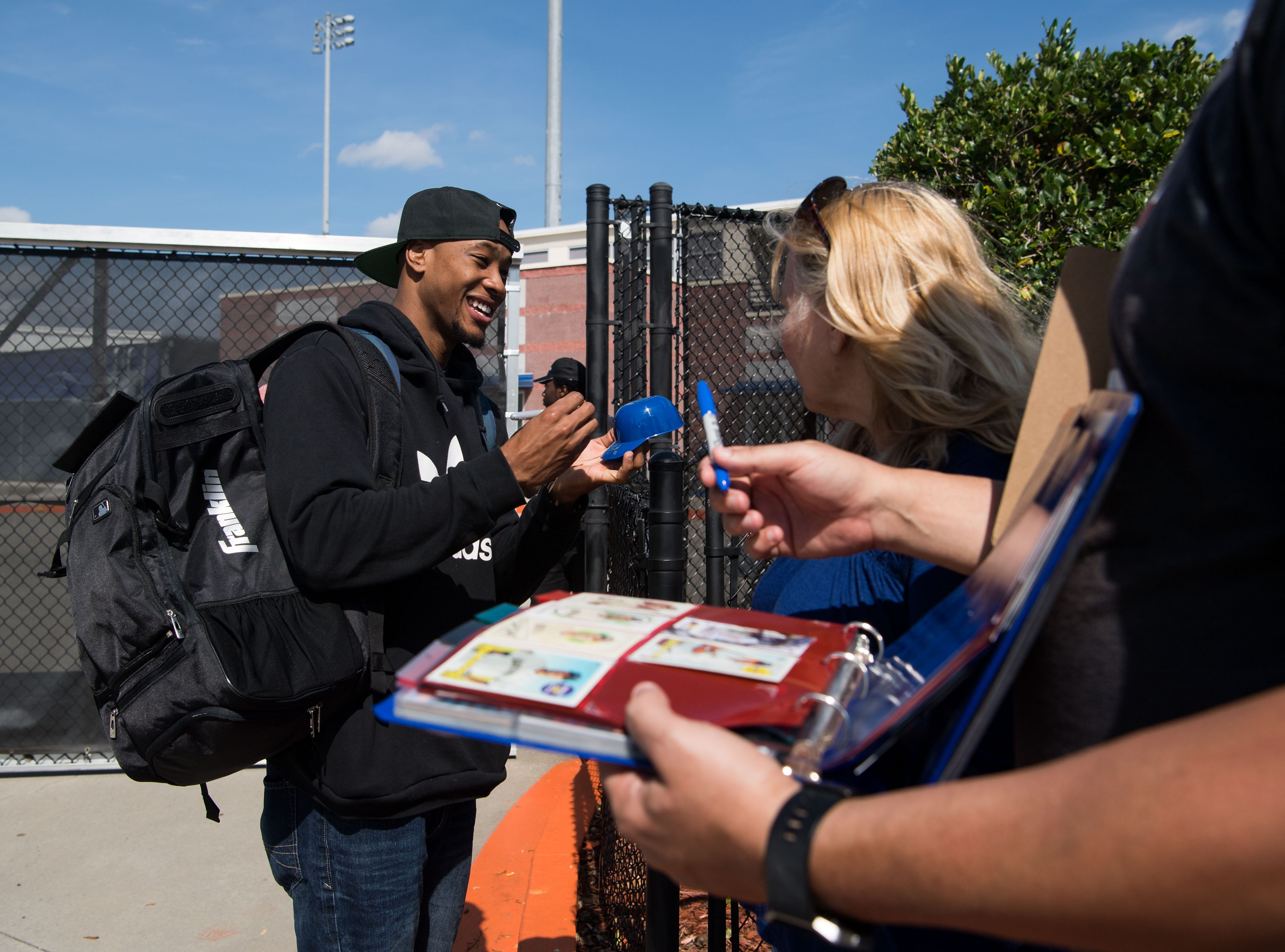 New York Mets outfielder Keon Broxton signs autographs and takes photos with fans attending spring training Saturday, Feb. 16, 2019, at First Data Field in Port St. Lucie.