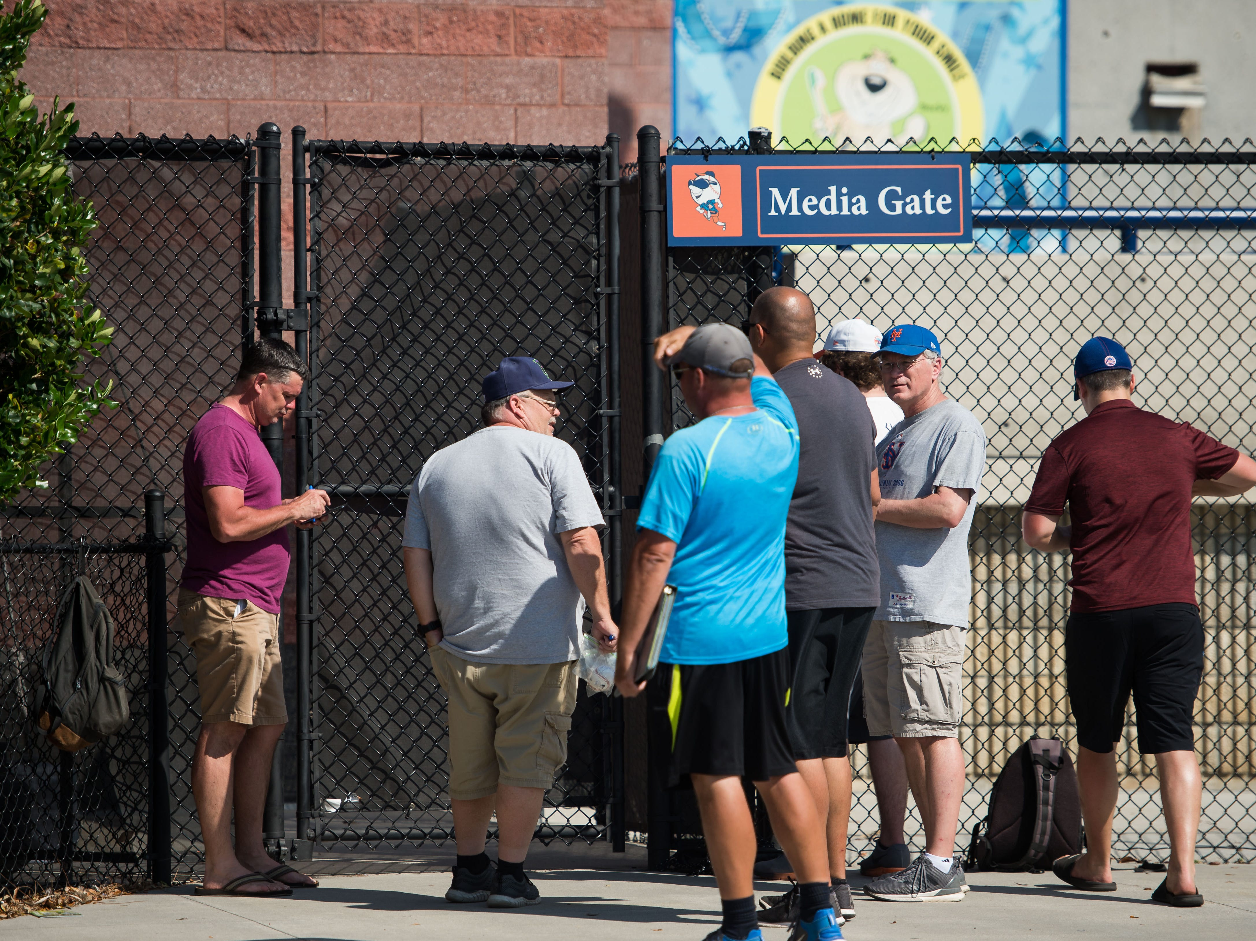 New York Mets fans try to get autographs of players attending spring training Saturday, Feb. 16, 2019, at First Data Field in Port St. Lucie.