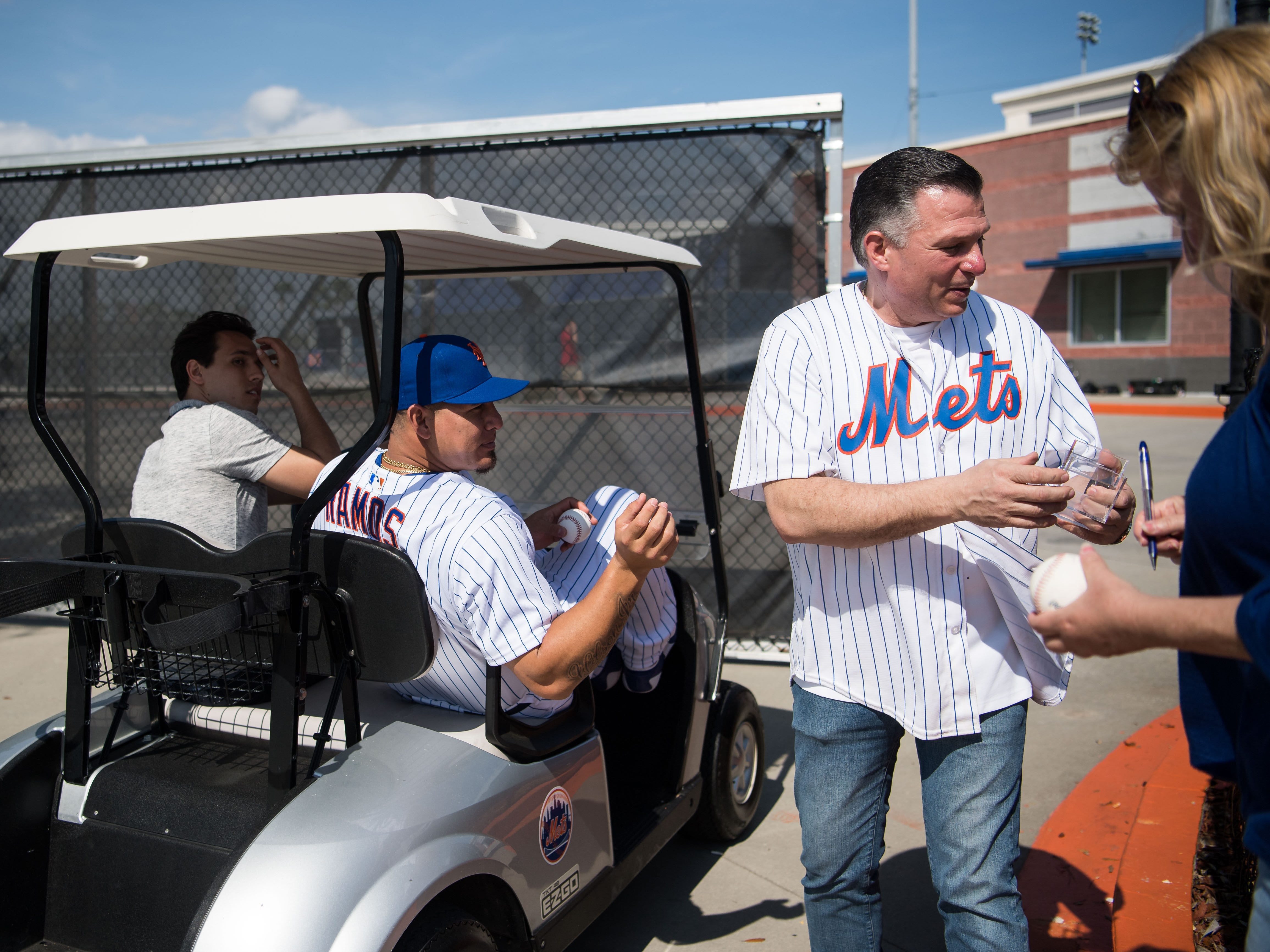 New York Mets catcher Wilson Ramos signs autographs for fans, including Henry Iervolino (right), of Long Island, at spring training Saturday, Feb. 16, 2019, outside the ballpark at First Data Field in Port St. Lucie.