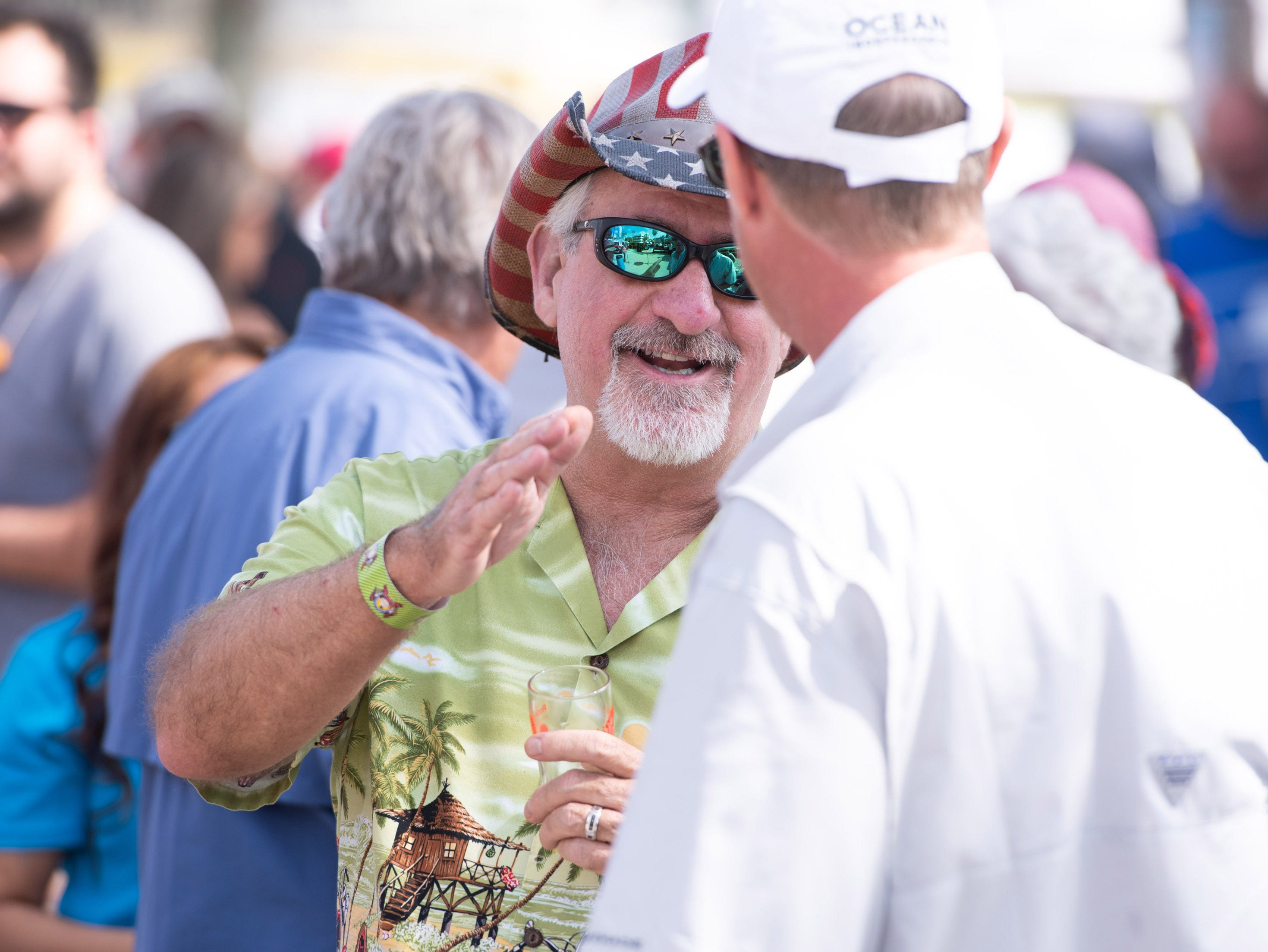 "Roger Tull (left), of Lake Worth, socializes with friend Ty Jennings, of Wellington, during the Florida Craft Brew and Wingfest at Royal Palm Pointe on Saturday, Feb. 16, 2019, in Vero Beach. ""We are having a great time,"" said Tull."