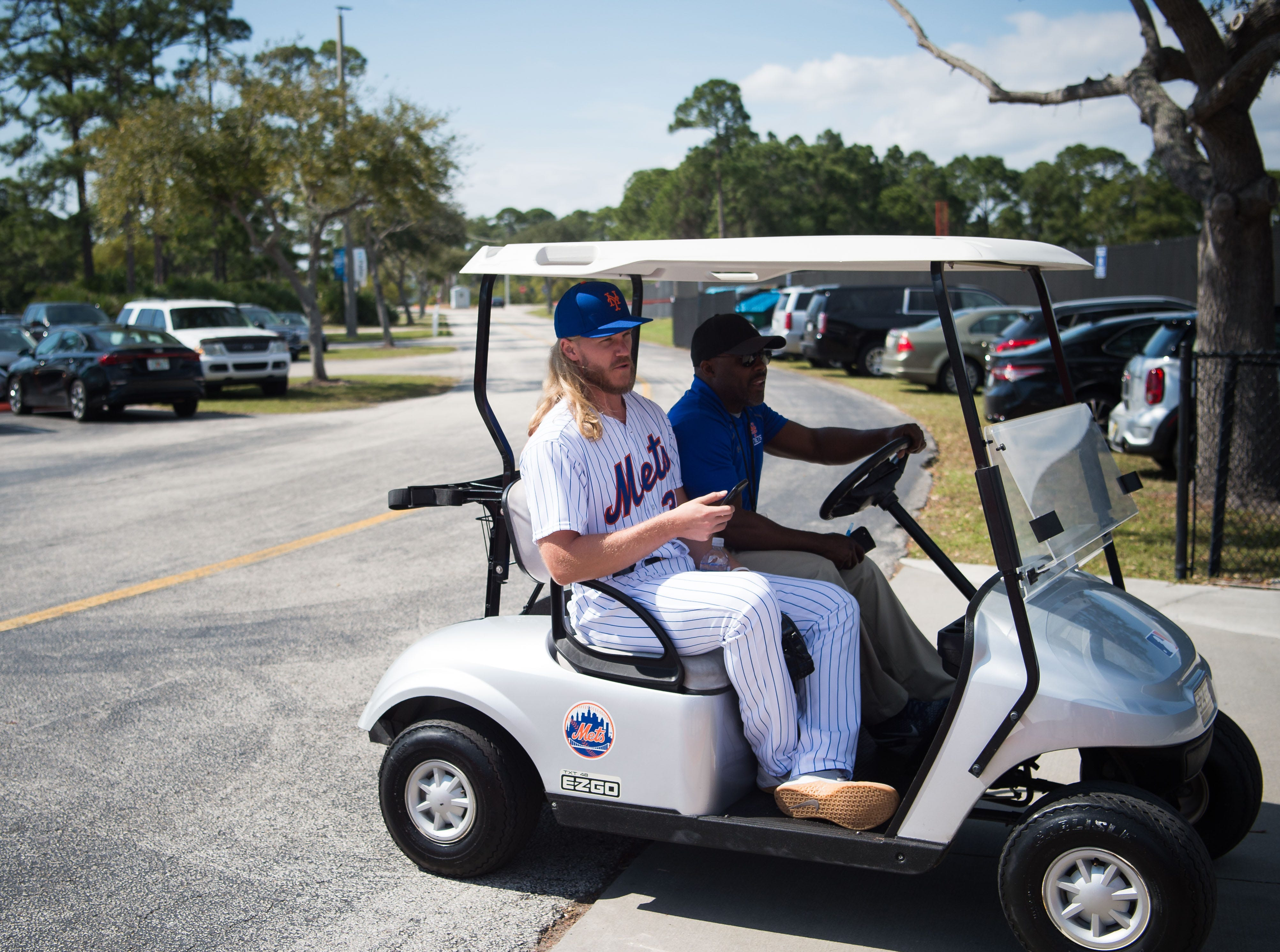 New York Mets pitcher Noah Syndergaard approaches fans trying to get autographs of players attending spring training Saturday, Feb. 16, 2019, at First Data Field in Port St. Lucie.