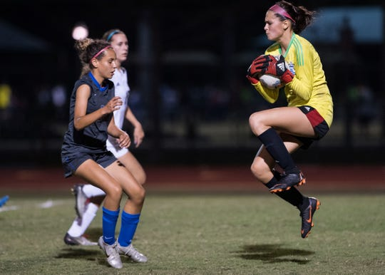 Vero Beach goalkeeper Lucia Romero (right) gets to the ball ahead of Cypress Bay's Fabiola Menendez during the first half of the high school girls soccer Class 5A state semifinal game Friday, Feb. 15, 2019, at Cypress Bay High School in Weston.