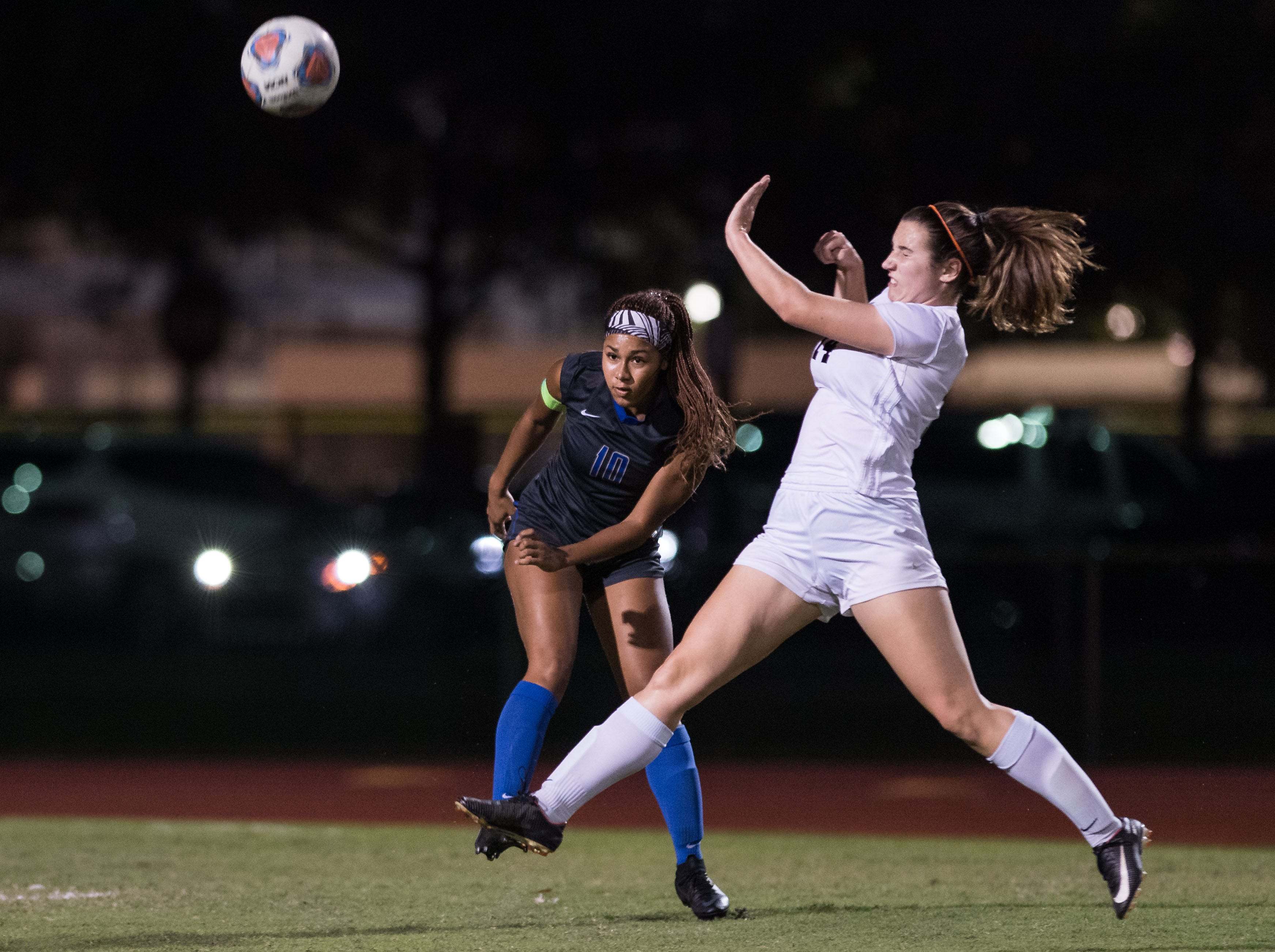 Cypress Bay's Maya Gordon clears the ball away from Vero Beach's Emma Romans during the first half of the high school girls soccer Class 5A state semifinal game Friday, Feb. 15, 2019, at Cypress Bay High School in Weston.