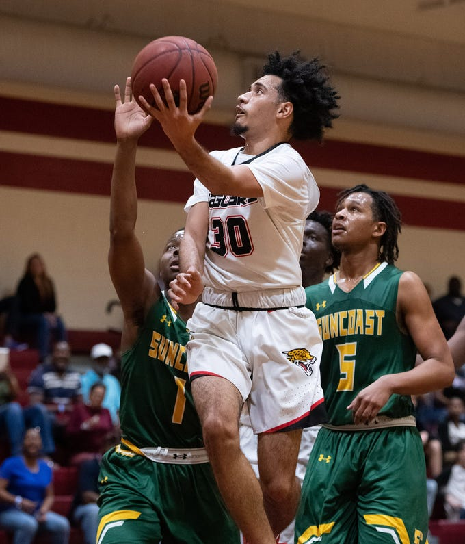 Port St. Lucie High School's Nate Davila puts a shot up against Suncoast in the first half of their District 15-6A basketball district championship game at Fort Pierce Westwood High School on Friday, Feb. 15, 2019, in Fort Pierce.