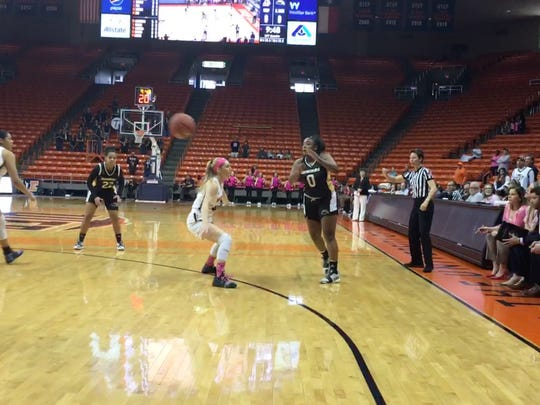 Southern Miss' Camille Anderson passes against the defense of UTEP's Katarina Zec Saturday at the Don Haskins Center