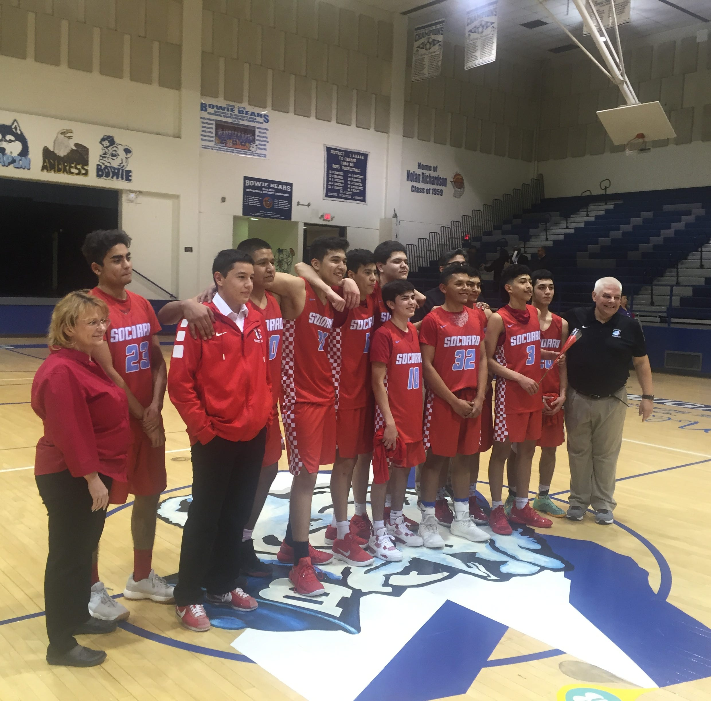 The Socorro Bulldogs pose for a photo after clinching a playoff berth in the state basketball playoffs for the first time since 1997.