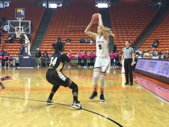 UTEP's Zuzanna Puc passes against the defense of Southern Miss' Respect Leaphart earlier this season at the Don Haskins Center