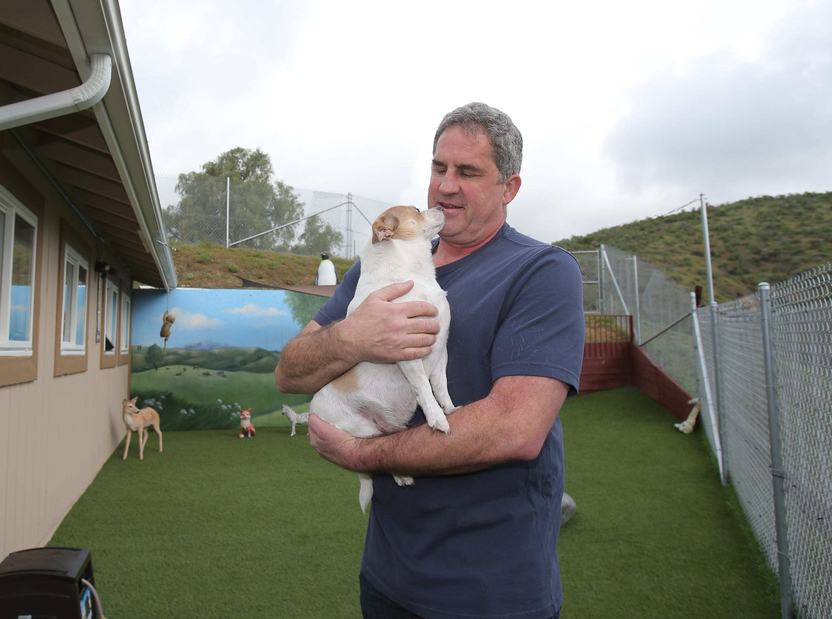 Ted Shumway holds Maxie in one of the play areas at his Wise Tails, senior dog sanctuary in Simi Valley. Shumway is the founder of the sanctuary that is home to 20 senior dogs, most of them rescued from local animal shelters. His nonprofit is coming up on its first-year anniversary.