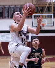 Mt. Whitney's Zack Reza goes up for two against Chavez in a Central Section Division III quarterfinal boys basketball game on Friday, February 15, 2019.