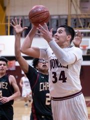 Mt. Whitney's Anthony Valencia shoots over Chavez's Tyrese Popoy in a Central Section Division III quarterfinal boys basketball game on Friday, February 15, 2019.