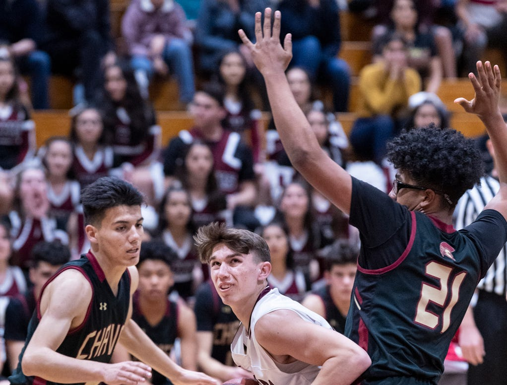 Mt. Whitney's Zach Scattareggia looks to shoot between Chavez's Fernando Carranza and Tyrese Popoy in a Central Section Division III quarterfinal boys basketball game on Friday, February 15, 2019.
