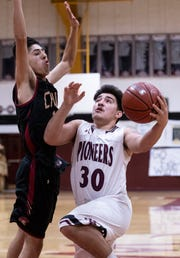 Mt. Whitney's Jaedyn Pineda goes up under pressure from Chavez's Jesus Lopez in a Central Section Division III quarterfinal boys basketball game on Friday, February 15, 2019.