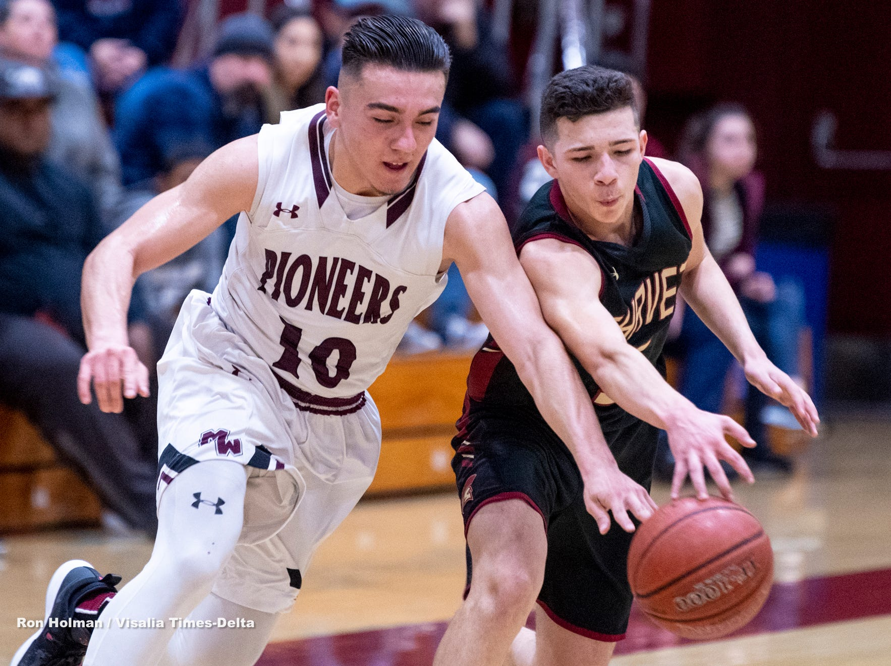 Mt. Whitney's Zack Reza, left, and Chavez's Adan Arredondo scramble for a loose ball in a Central Section Division III quarterfinal boys basketball game on Friday, February 15, 2019.