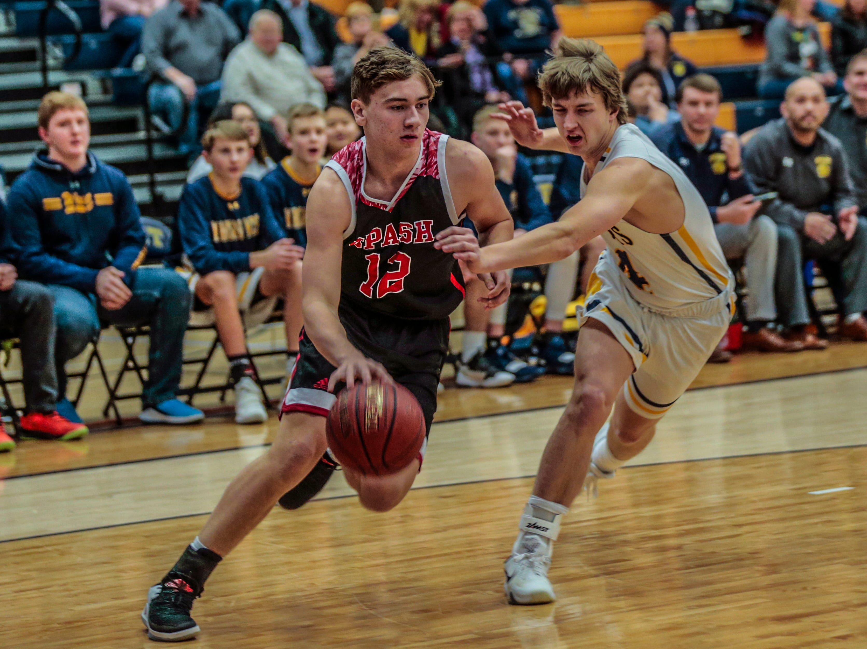 SPASH's Evan Vollendorf(12), left, dribbles pass West's Seth Kohl(4) during Wisconsin Valley Conference boys basketball game Friday, Feb. 15, 2019, at Wausau West High School in Wausau, Wis. T'xer Zhon Kha/USA TODAY NETWORK-Wisconsin