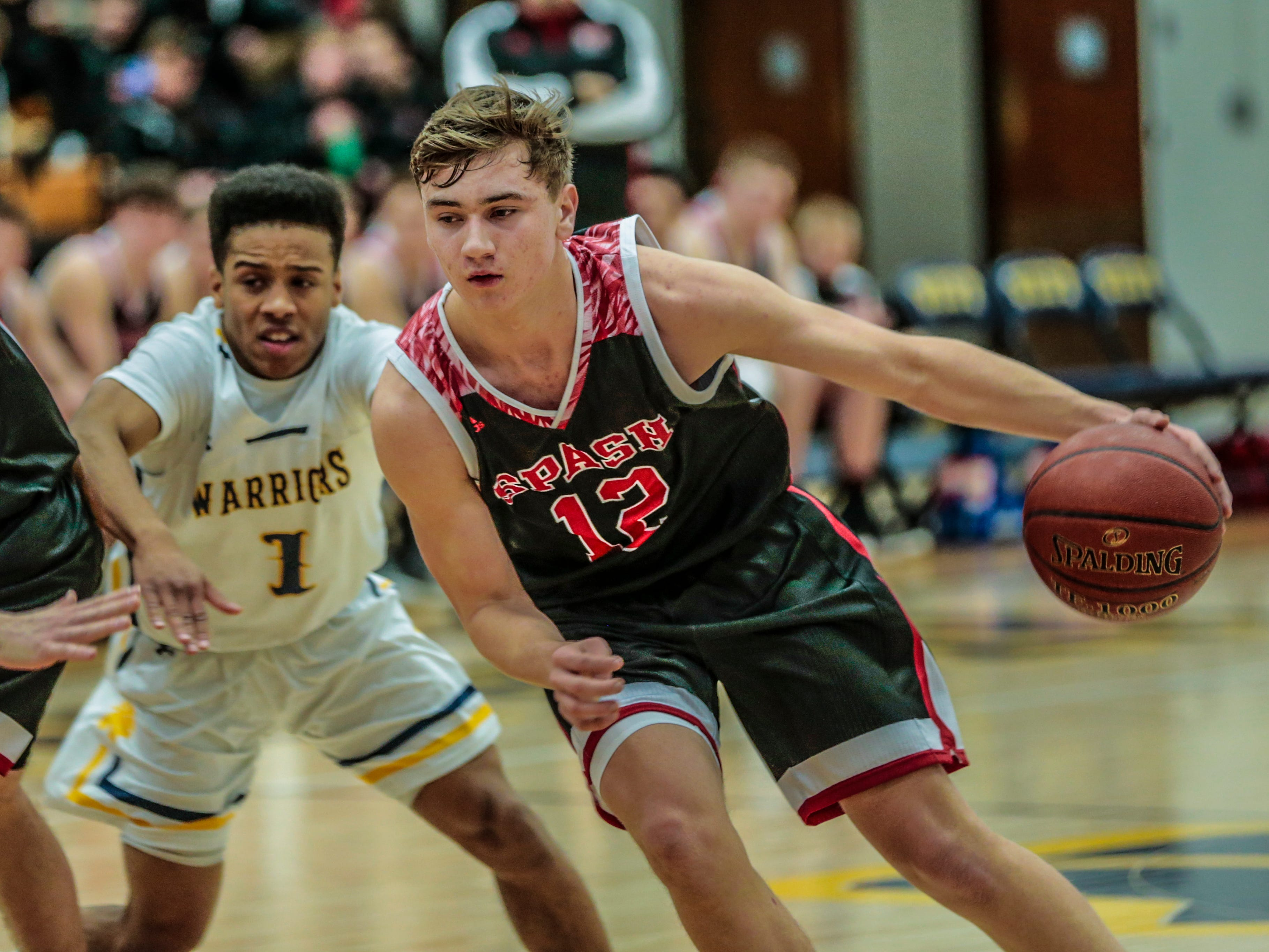 SPASH's Evan Vollendorf(12), right, makes his way pass West's Antonio Williams(1) during Wisconsin Valley Conference boys basketball game Friday, Feb. 15, 2019, at Wausau West High School in Wausau, Wis. T'xer Zhon Kha/USA TODAY NETWORK-Wisconsin