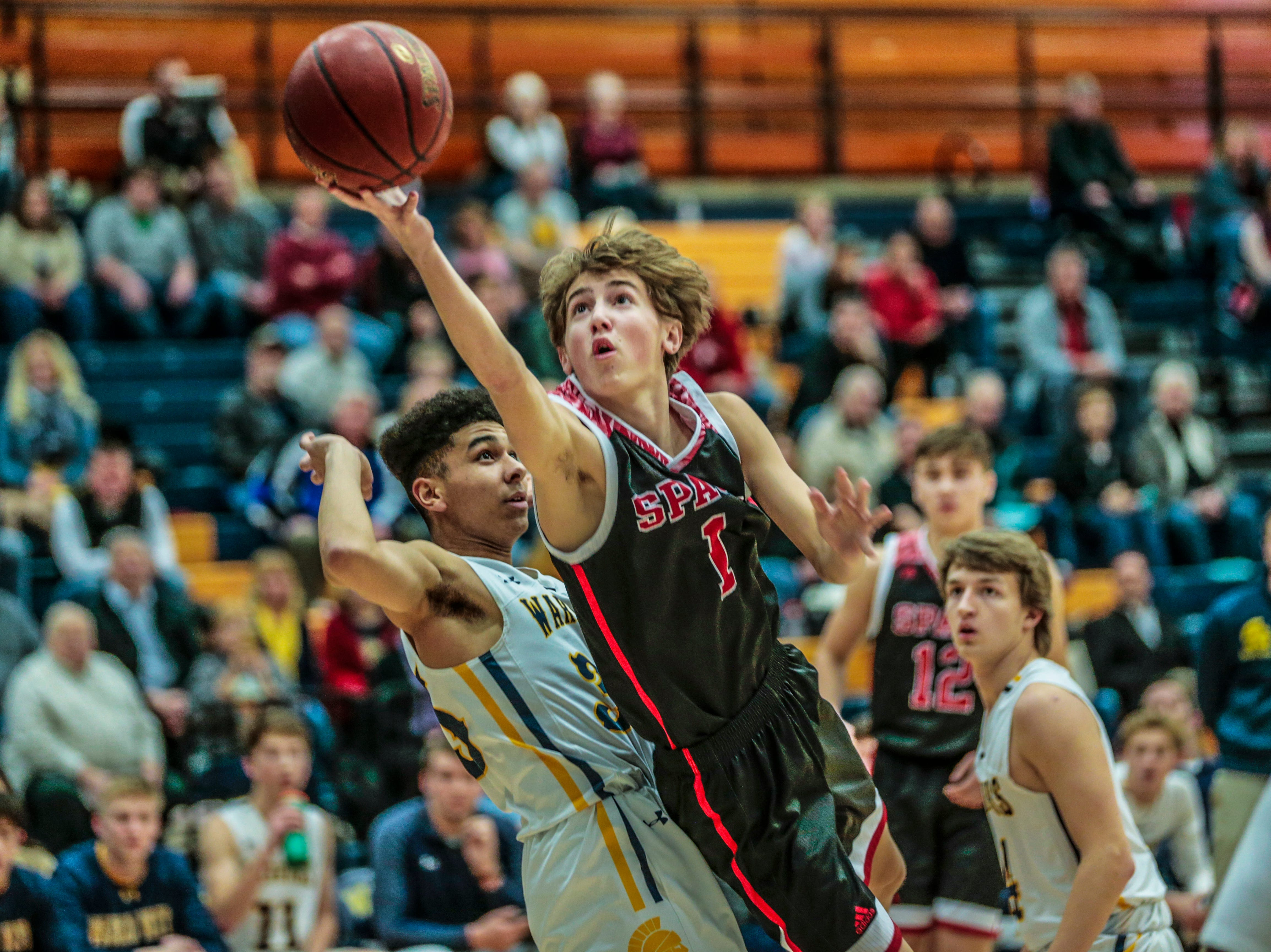 SPASH's Nolan Blair(1) aims for the hoop while West's Isaac McColley(35) attempts to stop during Wisconsin Valley Conference boys basketball game Friday, Feb. 15, 2019, at Wausau West High School in Wausau, Wis. T'xer Zhon Kha/USA TODAY NETWORK-Wisconsin