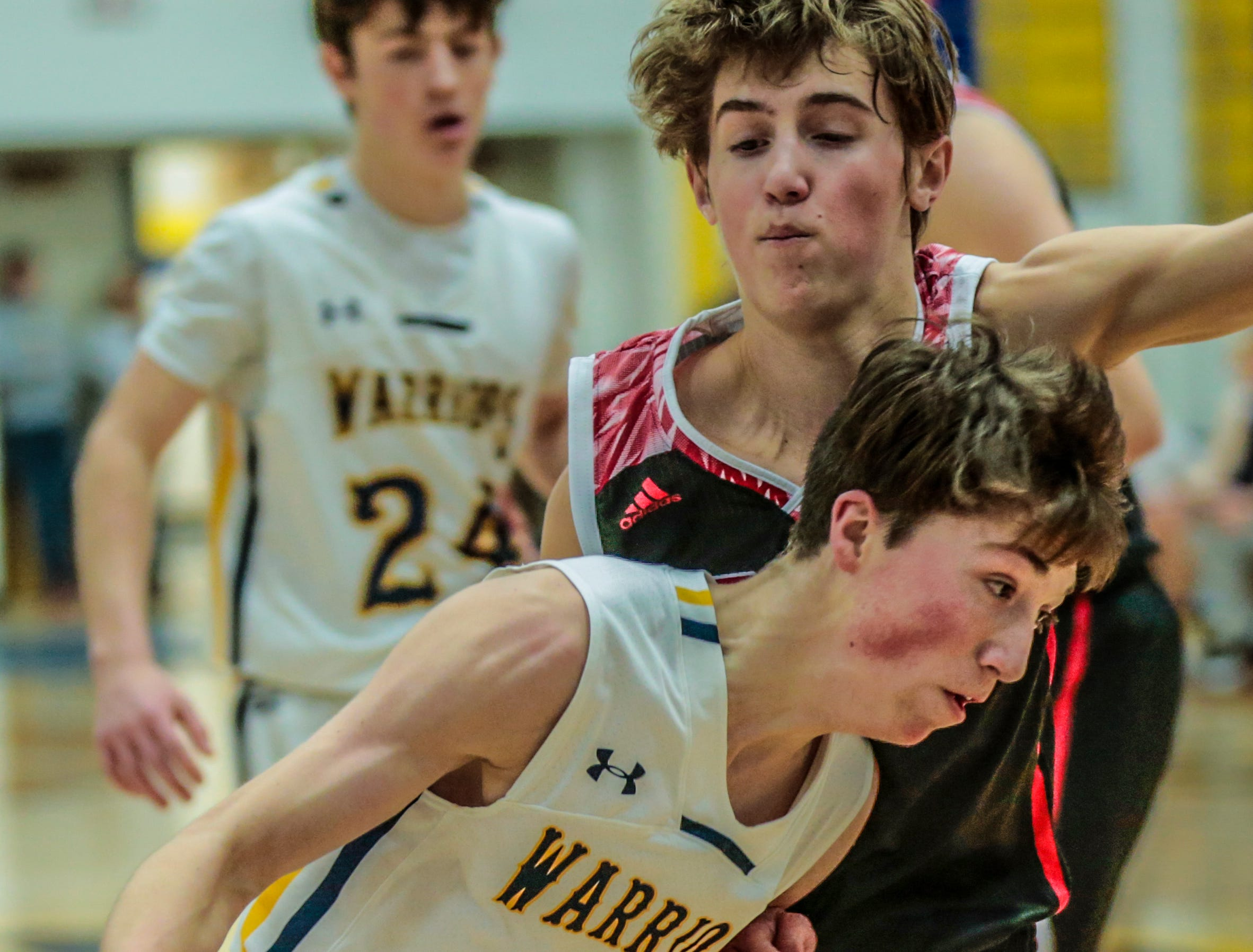 West's Tim Deloye(11), front, dribbles the ball away from SPASH's Nolan Blair(1) during Wisconsin Valley Conference boys basketball game Friday, Feb. 15, 2019, at Wausau West High School in Wausau, Wis. T'xer Zhon Kha/USA TODAY NETWORK-Wisconsin