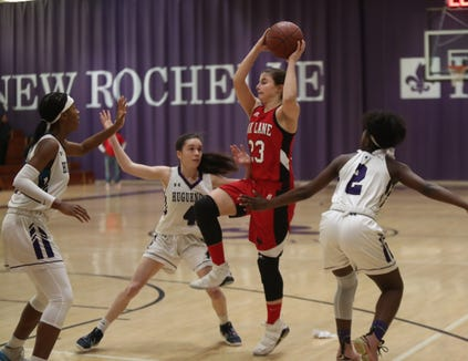 Fox Lane's Natalie Pence (23) feeds a pass over New Rochelle's Nora Fitzgerald (4) in the class AA girls basketball outbracket game at New Rochelle High School in New Rochelle on Saturday, February 16, 2019.