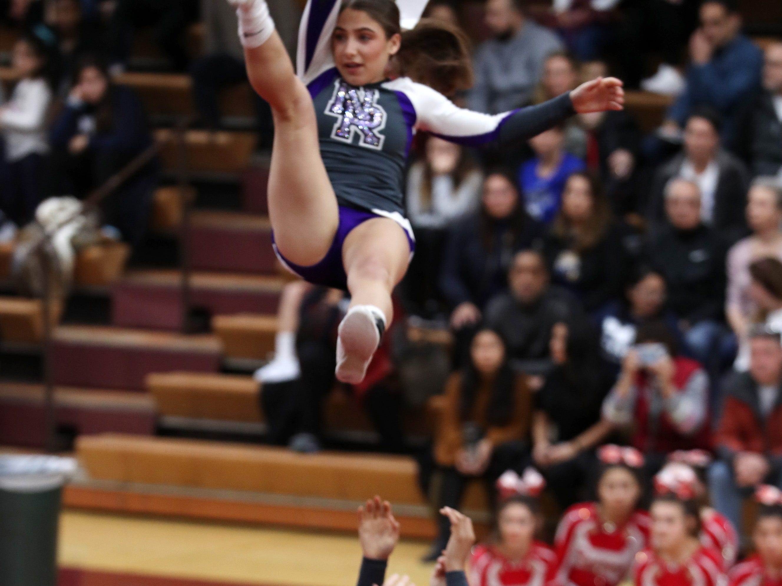 New Rochelle High School competes during the Section 1 cheerleading championships at Arlington High School in Freedom Plains Feb. 16, 2019.