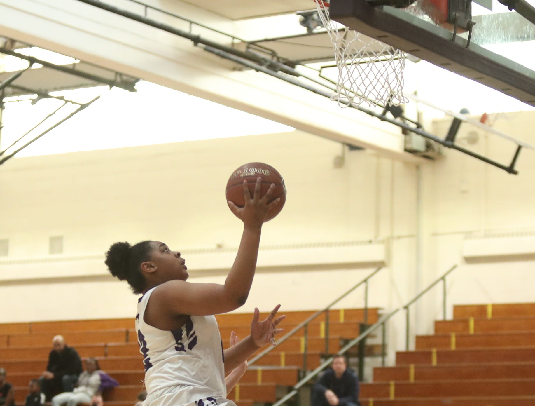 New Rochelle's Makira Bunsie (12) puts in a layup in the class AA girls basketball outbracket game against Fox Lane at New Rochelle High School in New Rochelle on Saturday, February 16, 2019.