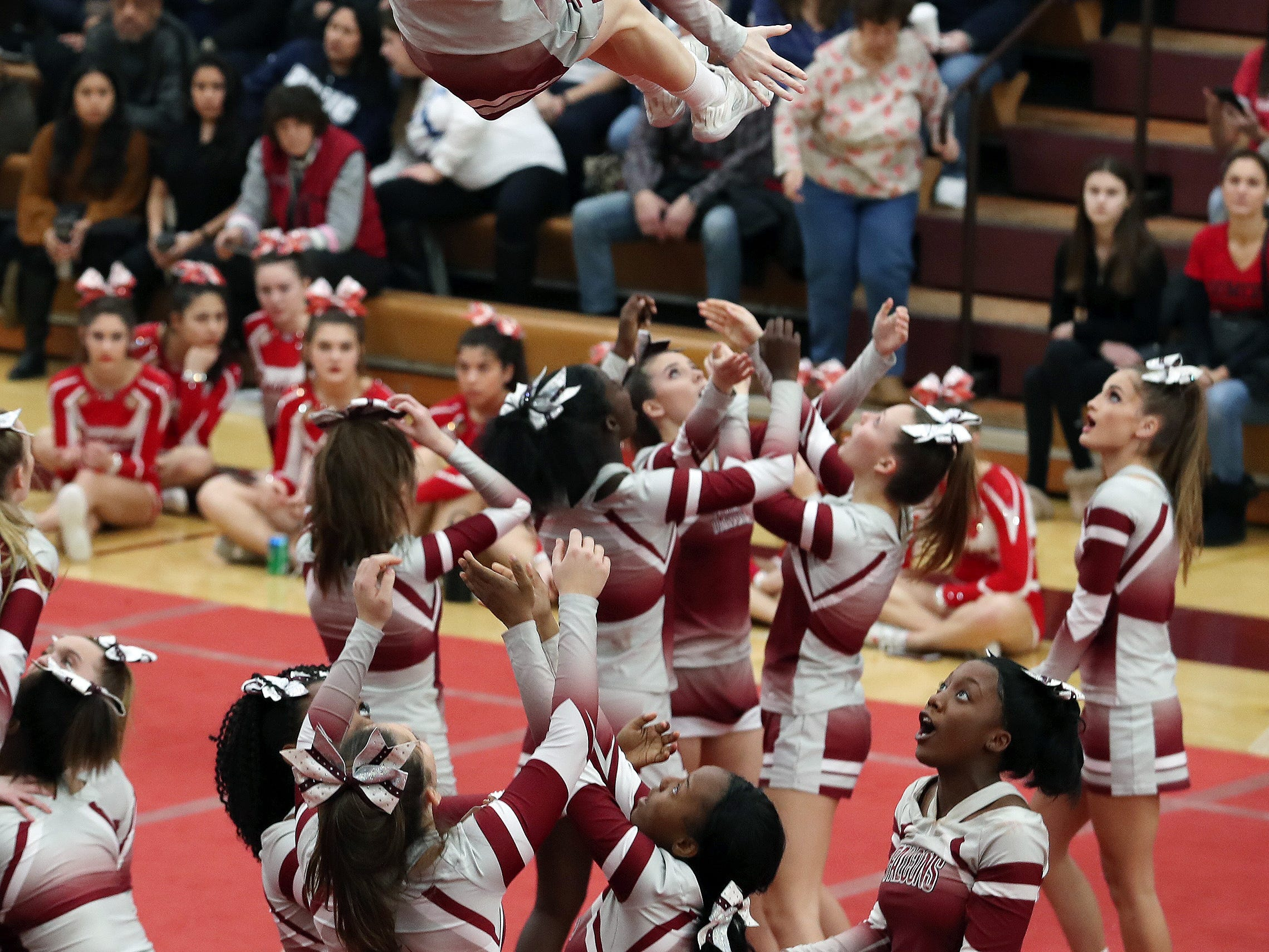 Alberts Magnus High School competes during the Section 1 cheerleading championships at Arlington High School in Freedom Plains Feb. 16, 2019.